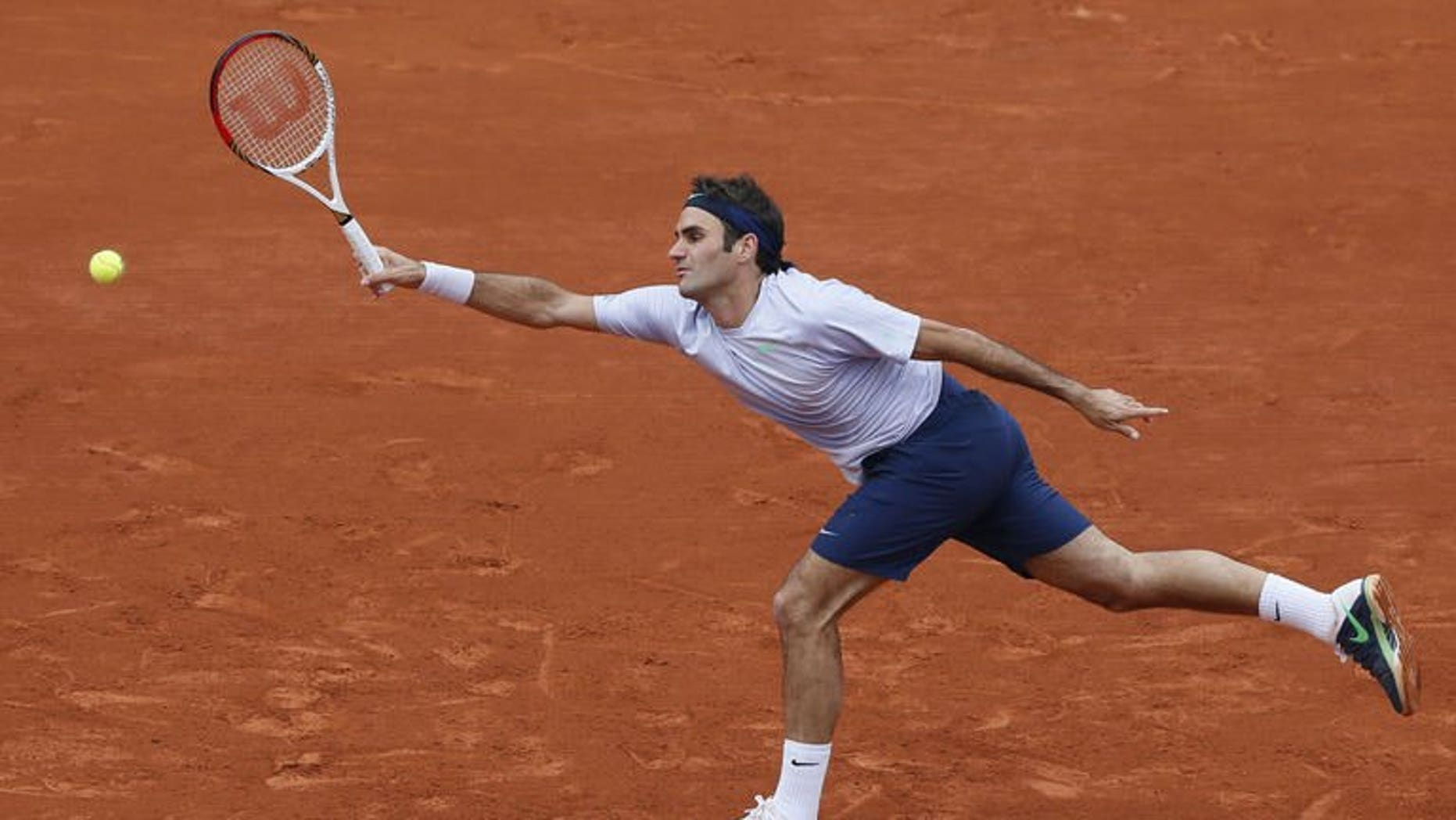 Switzerland's Roger Federer hits a forehand shot in Paris on May 31, 2013. Federer's faltering season suffered another twist on Friday when the former world number one pulled out of next week's Montreal Masters, a key warm-up for the US Open.