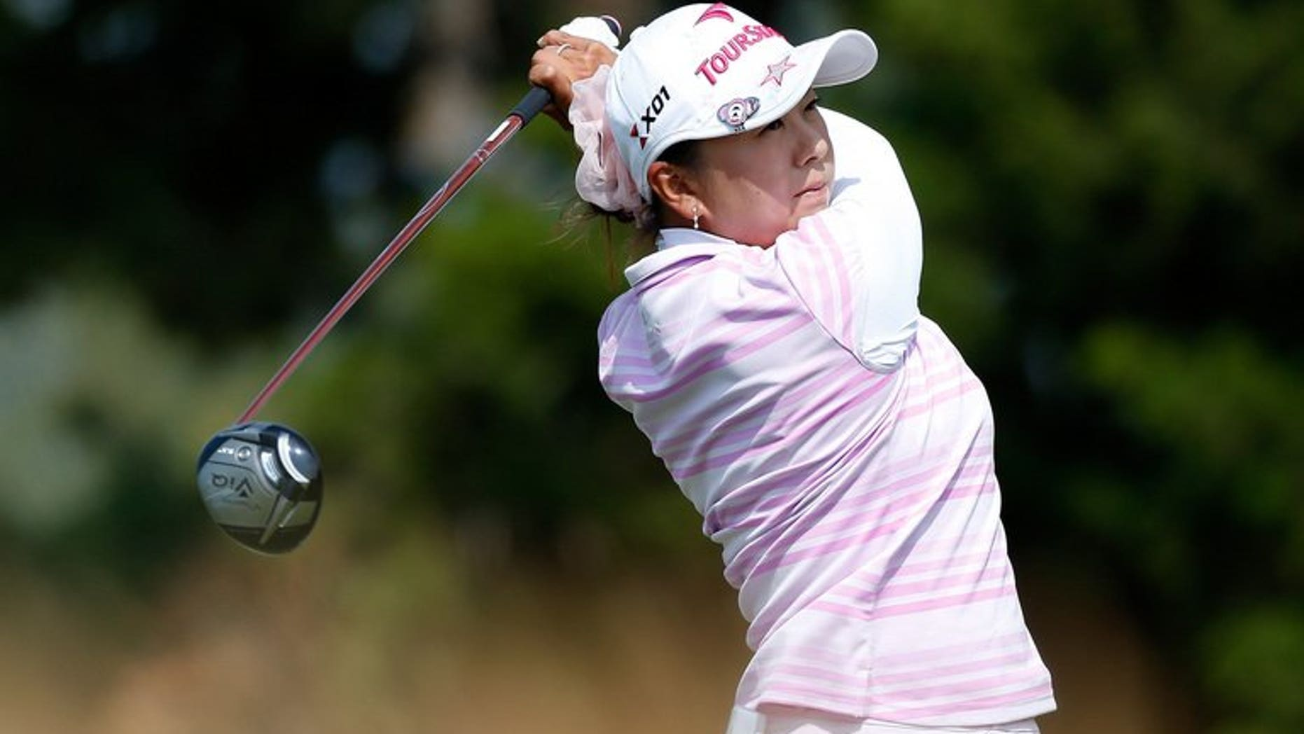 Miki Saiki of Japan watches her tee shot on the 15th hole at Sebonack Golf Club on June 28, 2013 in Southampton, New York. Saiki had a bundle of new experiences as she surged into the halfway lead on nine under par at the women's British Open at St Andrews on Friday.
