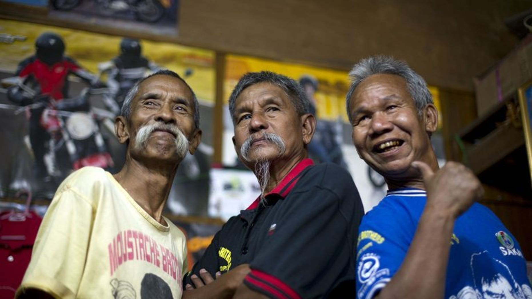 This picture taken on February 24, 2012 shows the 'Moustache Brothers', Lu Maw (L), Par Par Lay (C) and Lu Zaw, in Mandalay, Myanmar. Par Par Lay, 67, died at home on Friday shortly after he was released from hospital where he was taken with a kidney disease.
