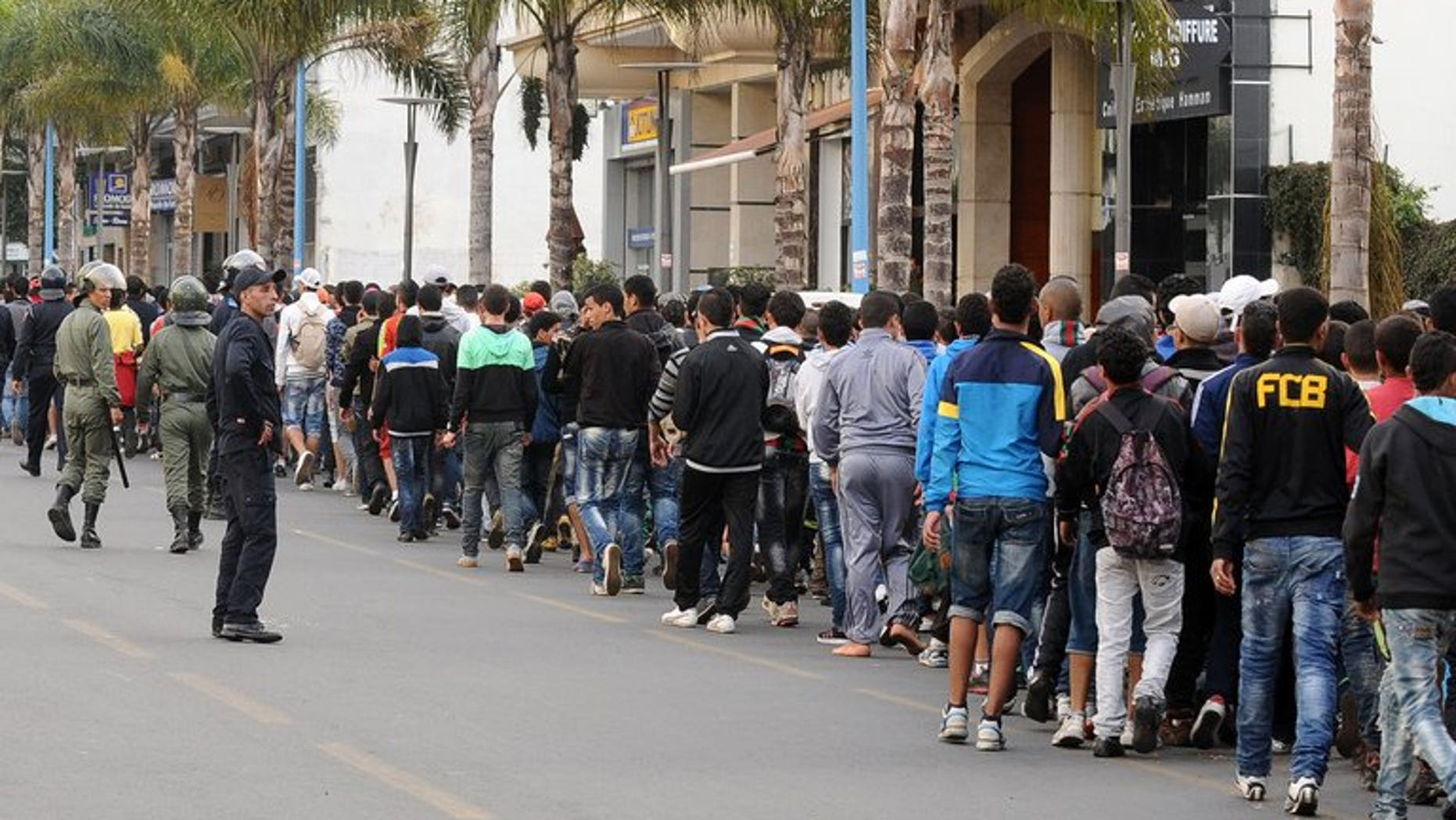 Supporters of Rabat FAR football club arrive at the Mohamed V complex on April 11, 2013 in Casablanca. A Moroccan court handed more than 130 people accused of football hooliganism before a match in Casablanca sentences of up to three years in prison, a judicial source said on Friday.