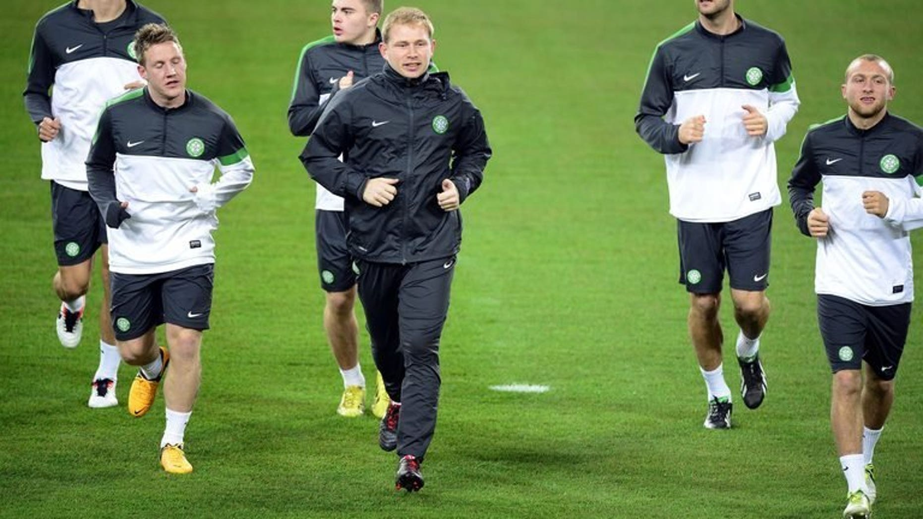Celtic players warm up during a training session in Turin on March 5, 2013. Celtic will start the season as overwhelming favourites to capture the inaugural Scottish Premiership crown after cantering to the title last year.