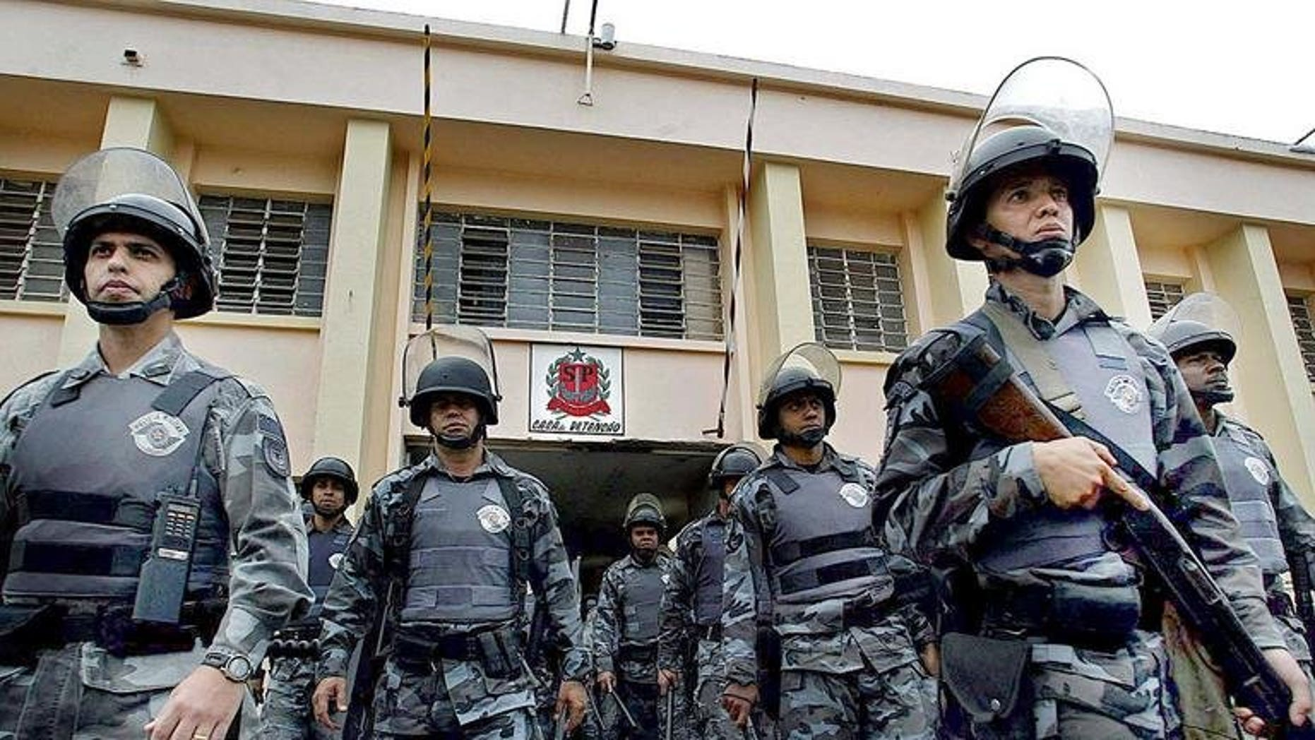 Brazilian anti-riot police provide security at the Carandiru jail 15 September 2002 in Sao Paulo, Brazil. Twenty-five police officers have been sentenced to life in prison for their role in the 1992 Carandiru prison massacre that left 111 prisoners dead.
