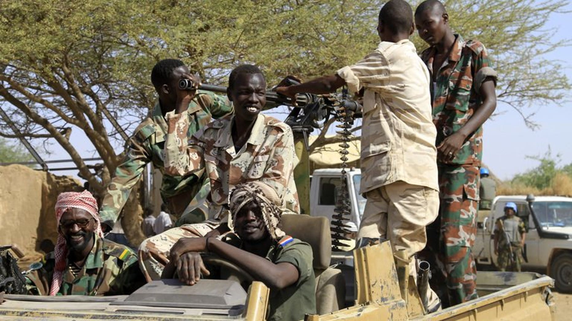 Sudanese soldiers keep watch in the Shangil Tobaya area for displaced people in North Darfur state, on June 18, 2013. A new outbreak of tribal violence in Darfur region has killed nine people, official media said, in fighting that has added to worsening insecurity in the region.