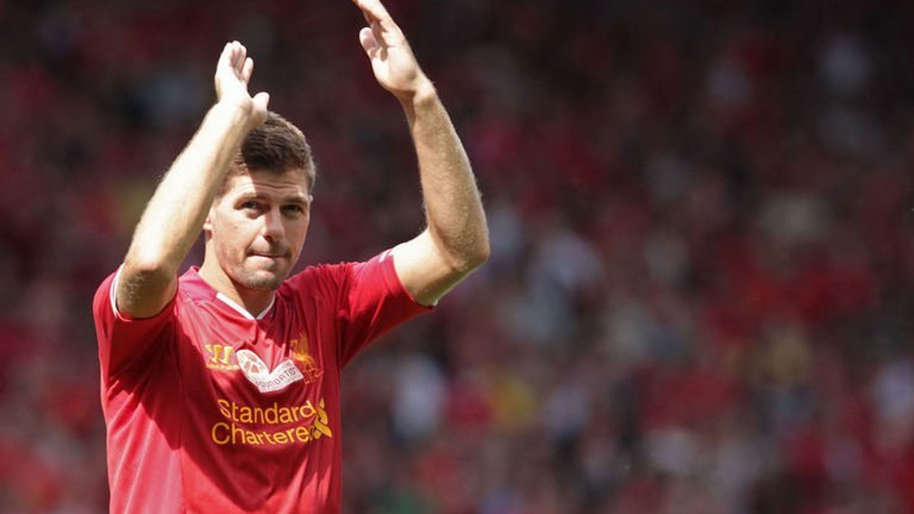 Liverpool captain Steven Gerrard waves to fans after their 2-0 win in the pre-season friendly match against Olympiakos in Liverpool on August 3, 2013. Liverpool supporters paid tribute to Gerrard as their Reds continued preparations for the start of the Premier League season with a 2-0 victory over Olympiakos.