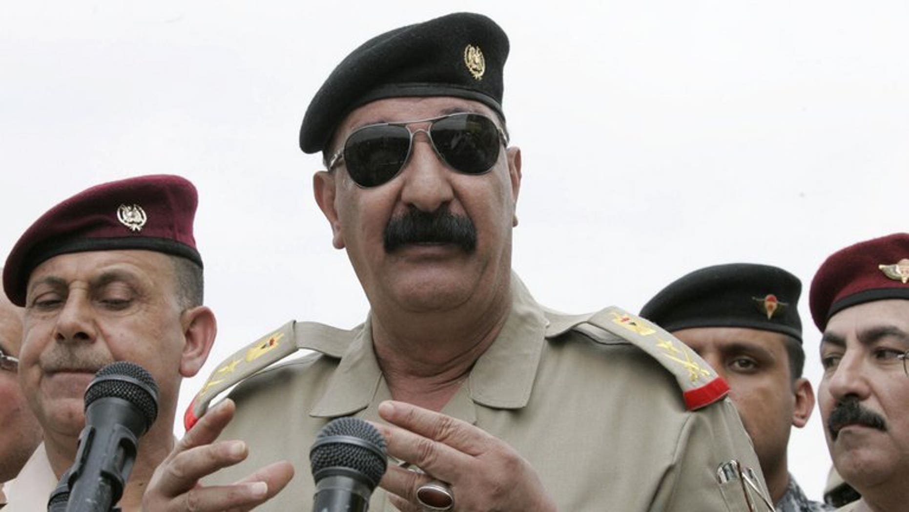 Iraqi Staff Lieutenant General Abdulamir al-Zaidi addresses troops in Kirkuk on October 21, 2012. Zaidi said he survived a bombing on Saturday that killed nine soldiers during an operation against Al-Qaeda militants in Diyala province north of Baghdad.