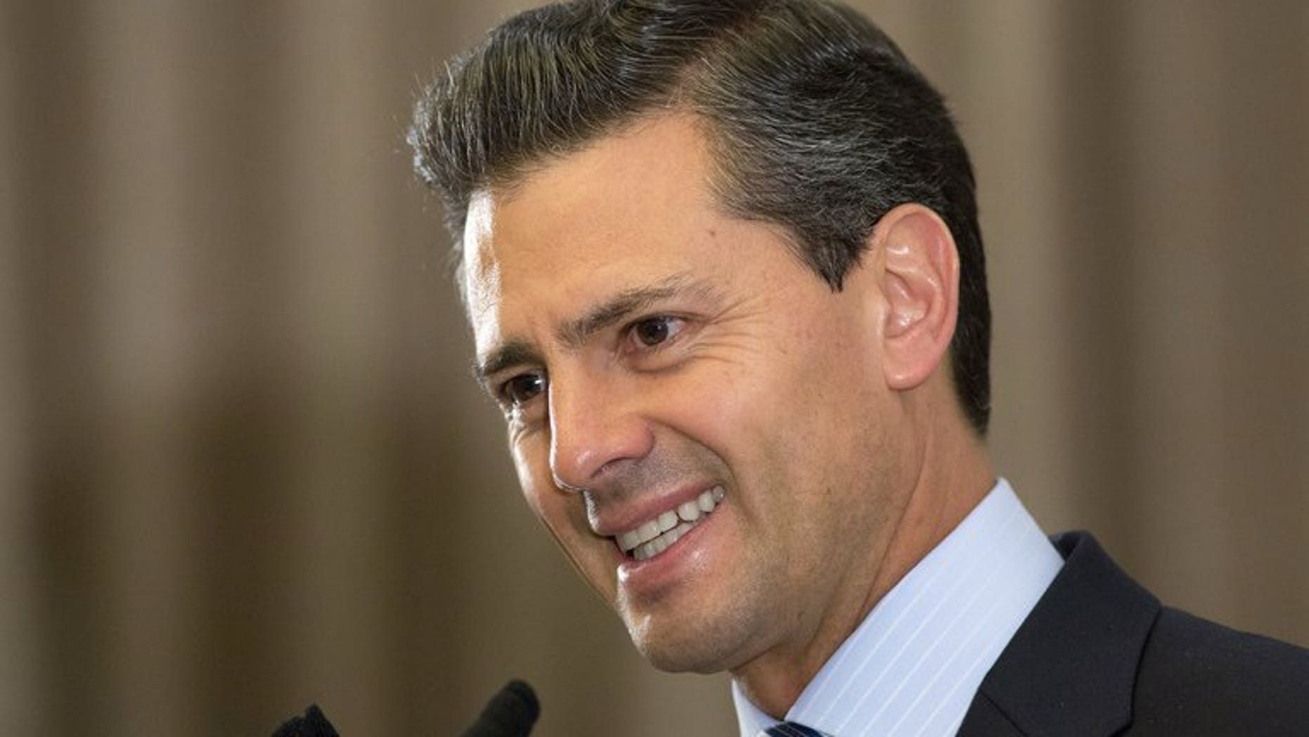 Mexican President Enrique Pena Nieto speaks during a press conference in Central London on June 18, 2013. Nieto left hospital Saturday saying he felt fine after undergoing surgery to remove a thyroid nodule and he hoped to fully return to work next week.