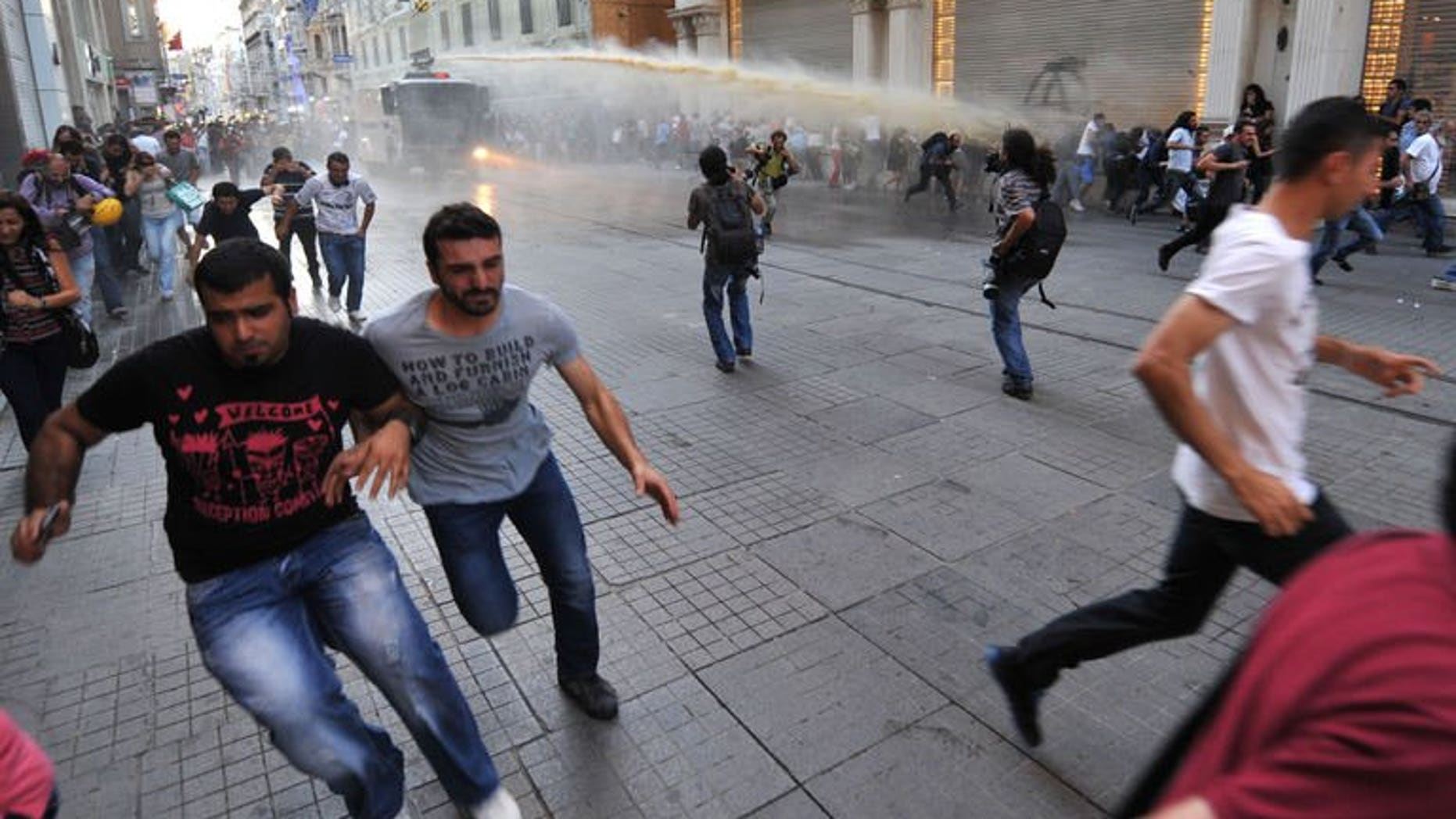 Turkish riot police use water cannon to disperse anti-goverment protestors during clashes at Istiklal street on August 3, 2013 in Istanbul.