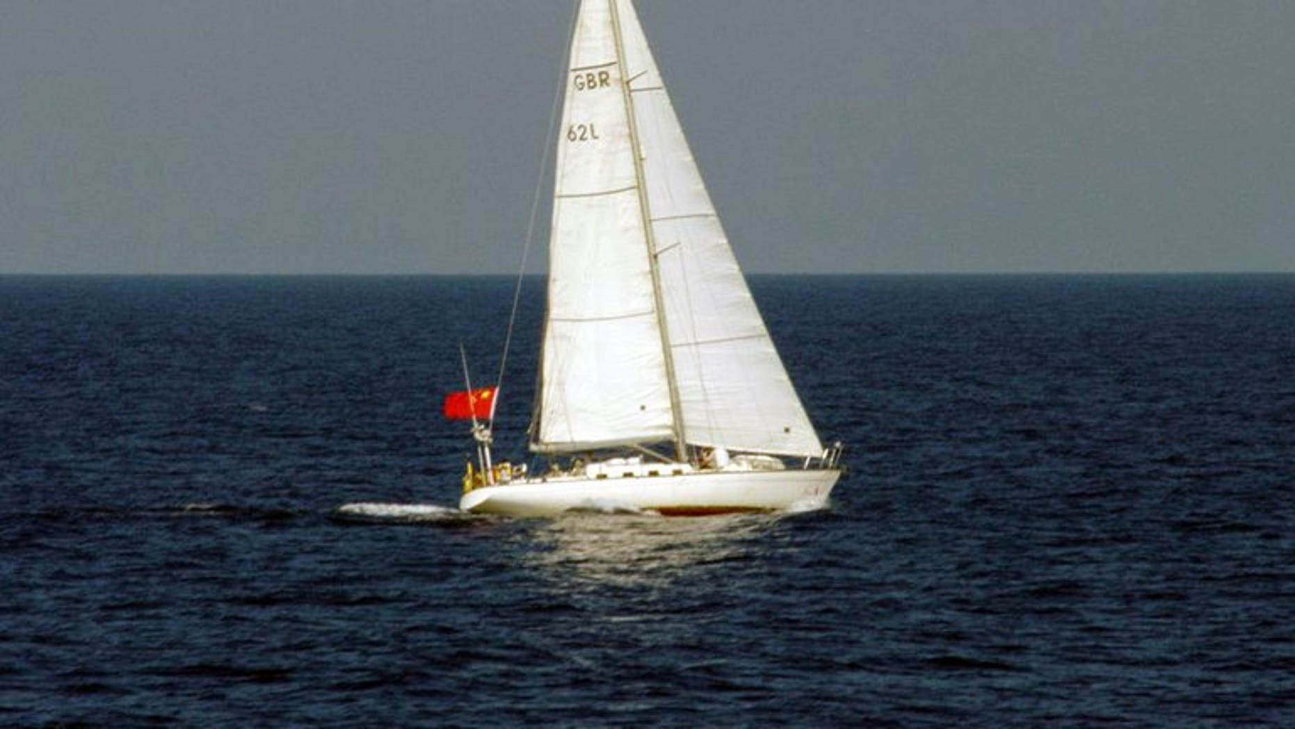 This photo, taken by Japan Coast Guard on August 3, 2013, shows a yacht of British registry carrying a Chinese flag as it cruises near the disputed islets known as the Senkaku islands in Japan and Diaoyu islands in China, in the East China Sea. The yacht entered Japan's territorial waters and sailers of the yacht threw a buoy with a red flag into the water and left the area.