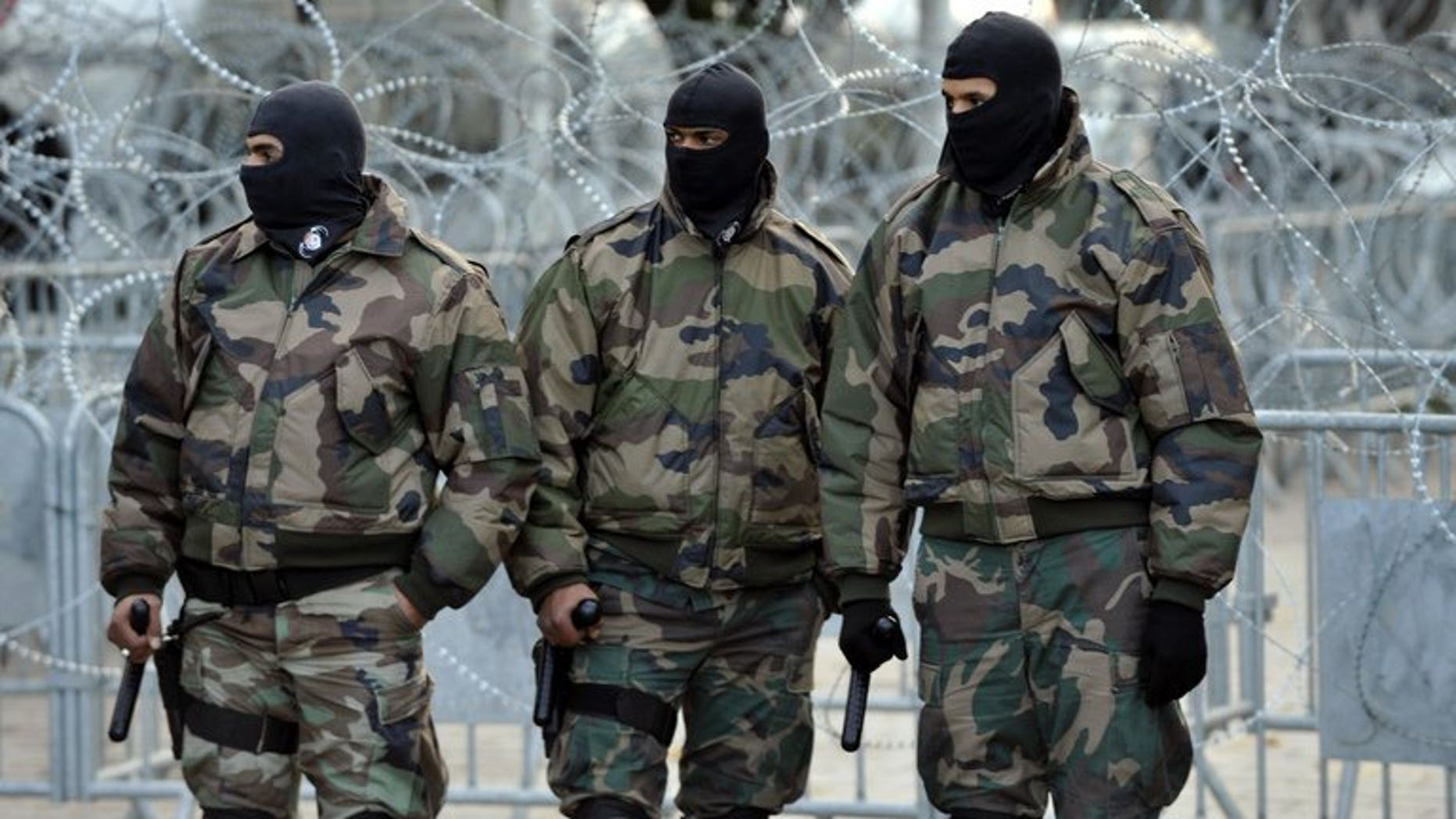 """Tunisian special security forces stand guard in Tunis on February 8, 2013. Tunisian security forces killed one """"terror"""" suspect and arrested four in a dawn raid on a house south of the capital,"""
