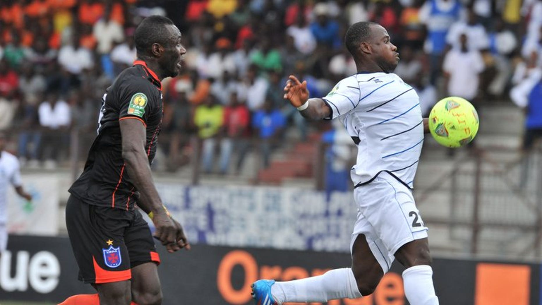 Ivory Coast's Sewe player Kevin Zougoula (right) vies for the ball with Recreativo Libolo of Angola player Edy Nycolas-Boyom during their African Champions league match at the Robert Champroux stadium in Abidjan on August 3, 2013. Zougoula scored a CAF Champions League hat-trick this weekend as Ivory Coast club Sewe San Pedro made a winning Group B debut.