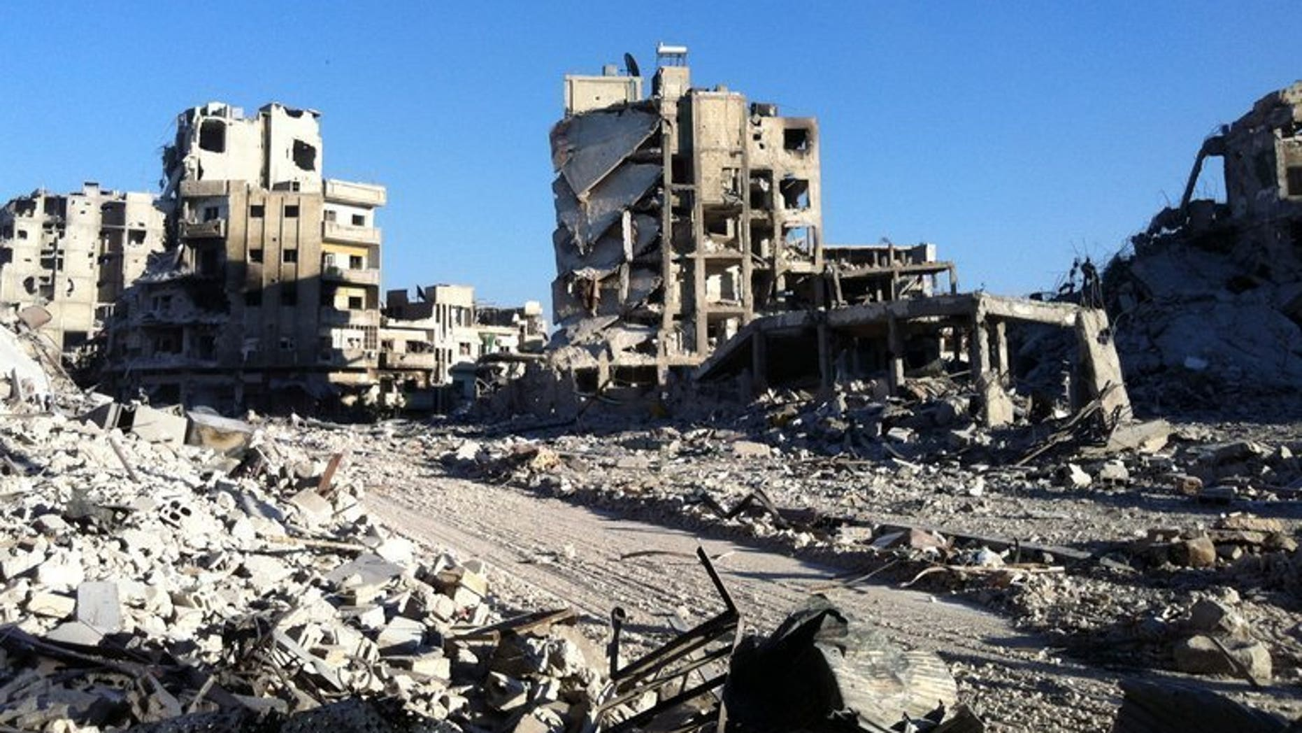 "Destroyed buldings are seen in the Khaldiyeh district of Homs, on July 28, 2013. Syrian President Bashar al-Assad, increasingly confident after his forces inflicted two major defeats on rebels in as many months, repeated on Thursday that he was ""sure of victory."""