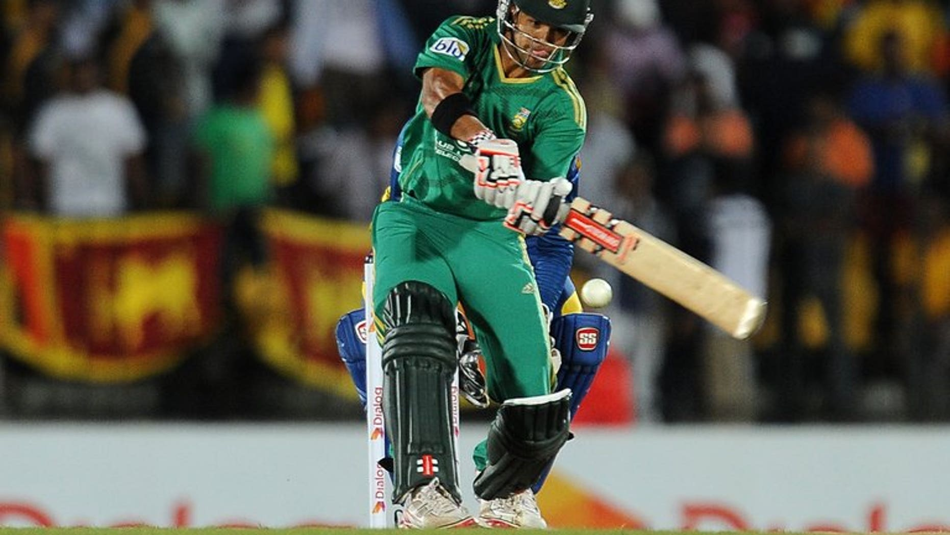 South African batsman JP Duminy plays a shot during the Twenty20 match against Sri Lanka in the district of Hambantota on August 4,2013. South Africa's captain Faf du Plessis won the toss and chose to bat in windy conditions in the second Twenty20 international against Sri Lanka in Hambantota