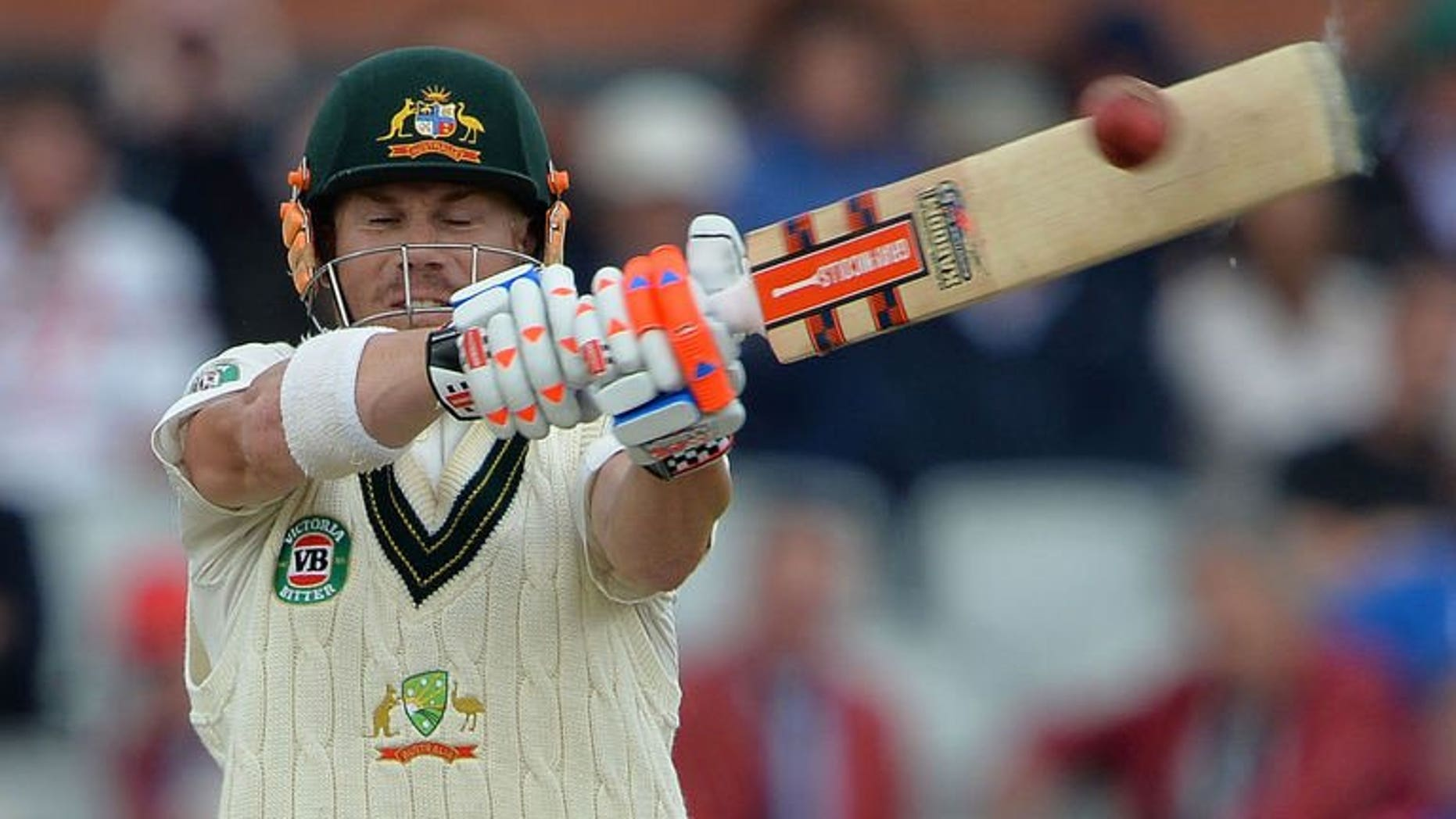 Australia's David Warner plays a shot at Old Trafford in Manchester on August 4, 2013. Warner insists he is relishing the jeers of the Old Trafford crowd that have accompanied his return to Test cricket.