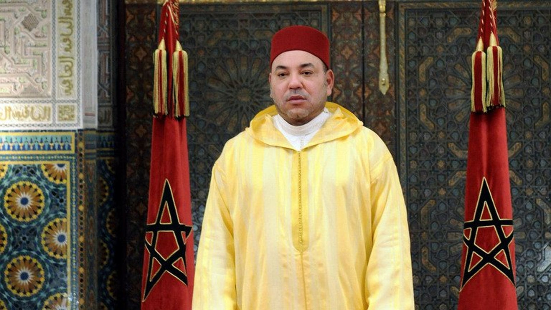 Handout photo released by Moroccan Press Agency shows King Mohammed VI on July 30, 2013 in Casablanca. King Mohamed VI of Morocco on Sunday revoked a pardon granted to a Spanish serial paedophile whose release sparked angry protests in the kingdom, a palace statement said.