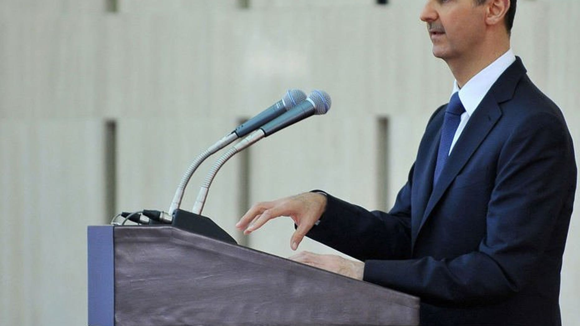 "President Bashar al-Assad gives a speech at an ""iftar"" meal in Damascus on August 4, 2013. Syria's crisis will only be solved by stamping out ""terror"", al-Assad said, in reference to rebels fighting his regime."
