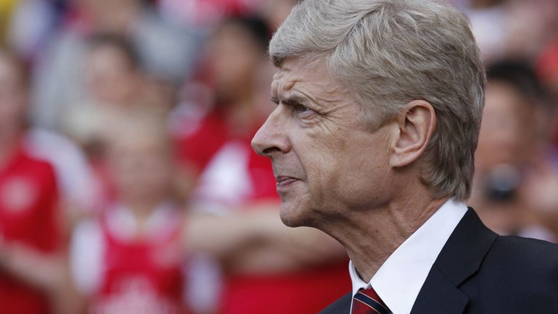 Arsenal's French manager Arsene Wenger looks on ahead of the pre-season friendly football match between Arsenal and Galatasaray at The Emirates Stadium in north London on August 4, 2013. Wenger admits Arsenal may be forced to go into their crucial Champions League qualifier without further additions to the squad.