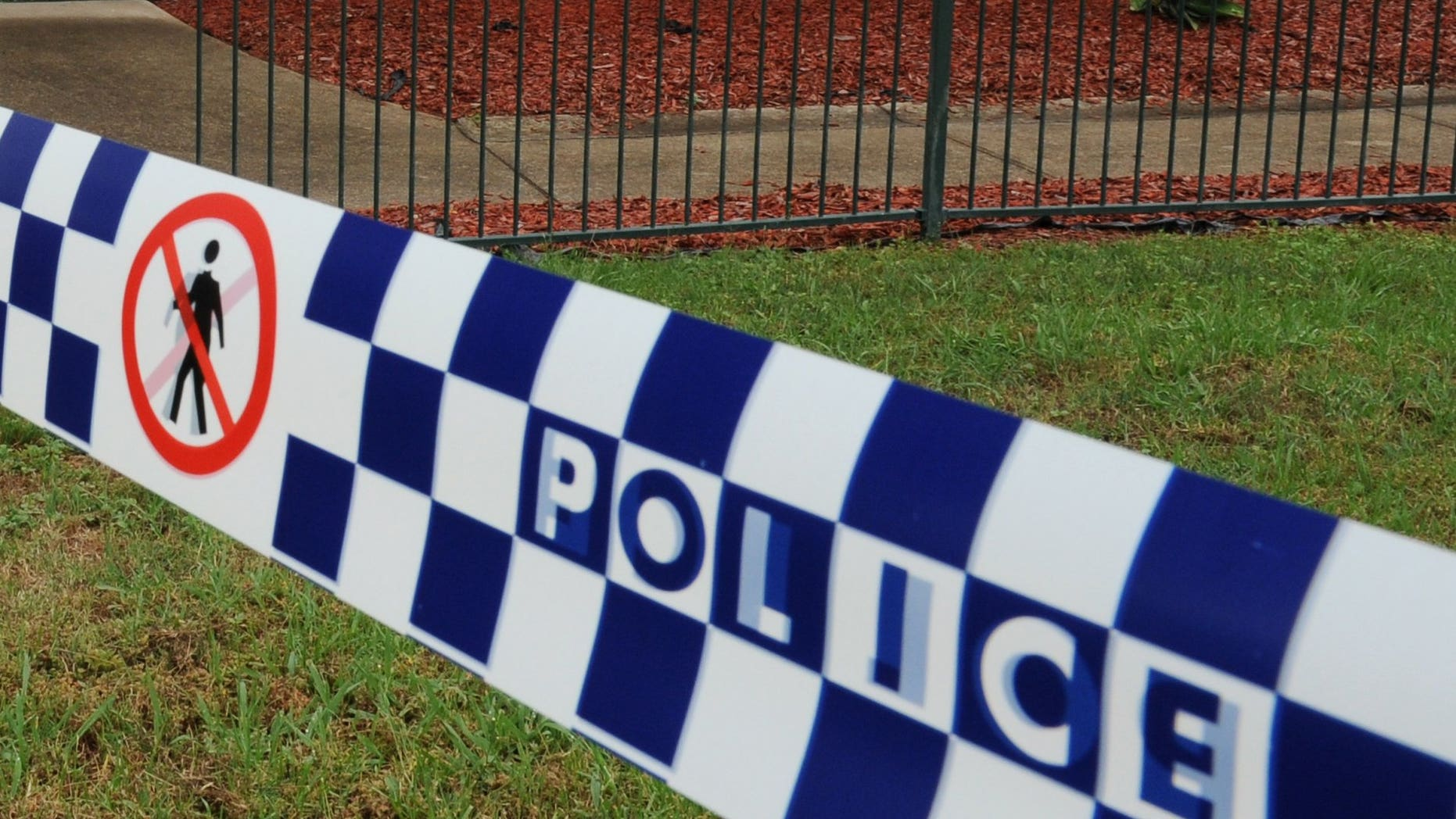 This file illustration photo shows a police tape cordoning off a crime scene near Sydney, in 2011. A two-year-old boy was mauled to death at his grandmother's house in a savage attack by a mastiff cross dog, Sunday afternoon at Deniliquin, in southwestern New South Wales.