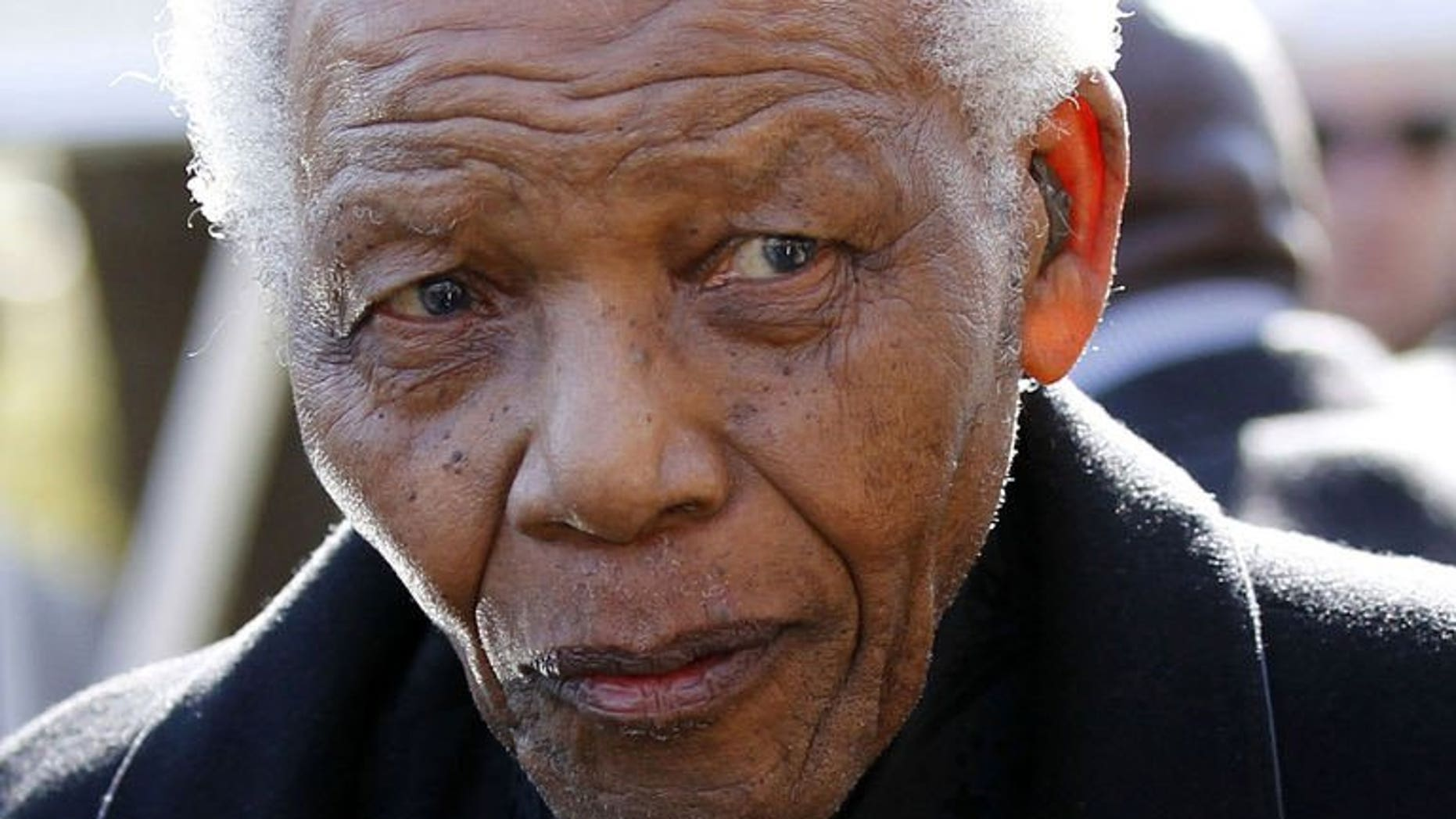 Former South African President Nelson Mandela is pictured in Sandton, north of Johannesburg on June 17, 2010. Authorities have admitted they had mistakenly delivered a utilities bill to Mandela's upmarket home and threatened to cut the icon's water and electricity supply.