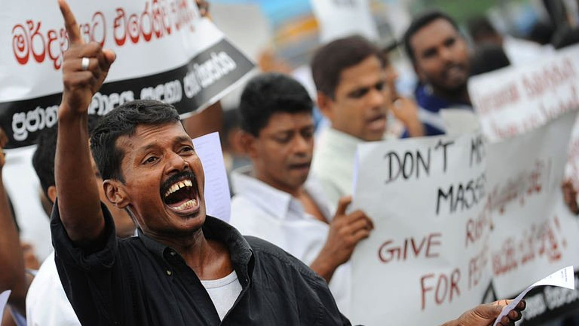 A supporter of Sri Lanka's Marxist JVP or People's Liberation Front demonstrates in the capital Colombo on August 5, 2013 to denounce a deadly army crackdown on villagers who were protesting against contaminated water supplies. Several hundred anti-government supporters staged the rare protest Monday.