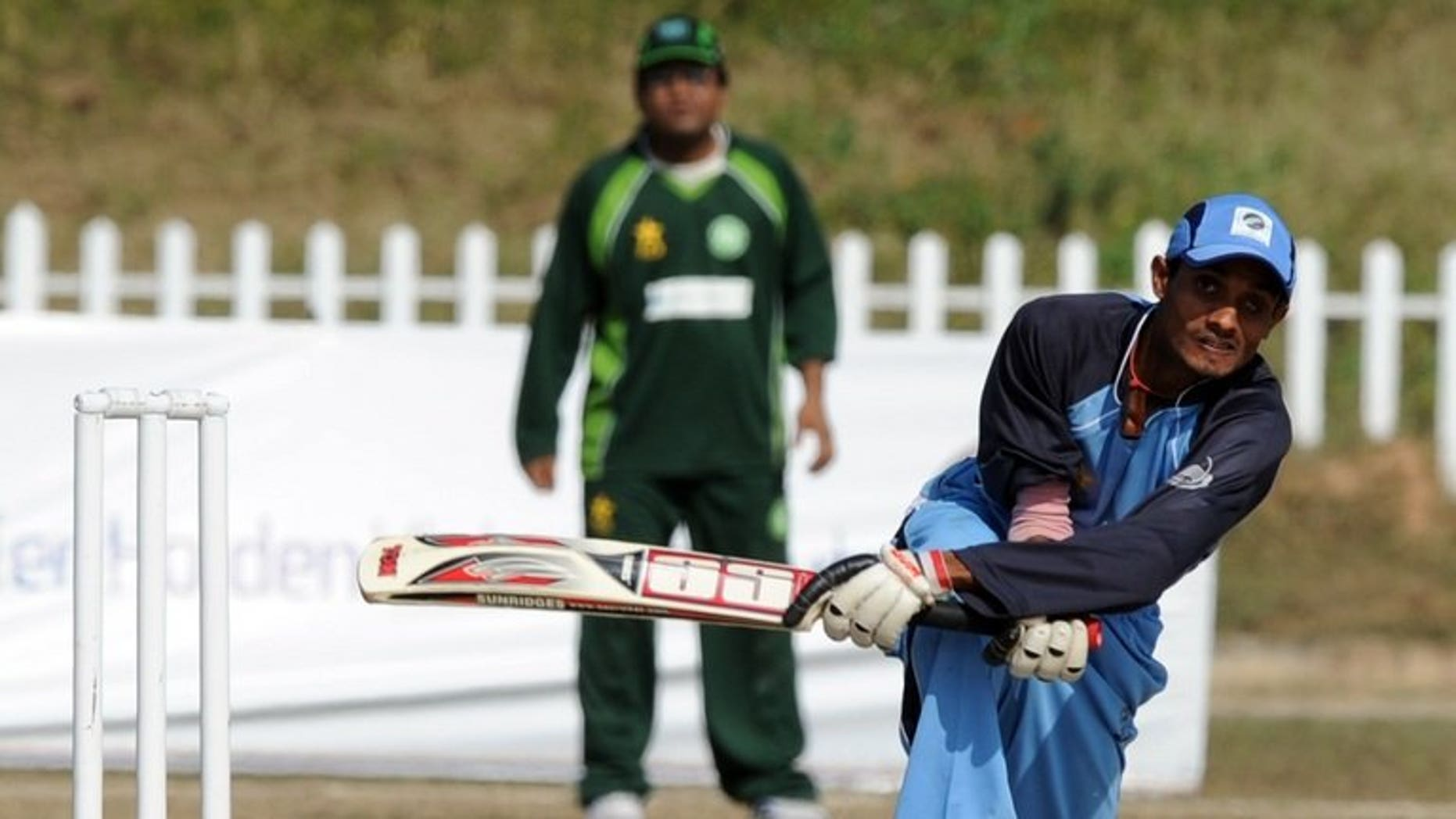 Visually impaired Indian cricketer Ganesh (R) plays a shot during their third and final blind cricket one-day international match between Pakistan and India in Islamabad on November 26, 2011. The body running cricket for the blind in Pakistan said Monday it has persuaded its counterparts in India to come on tour in February next year.