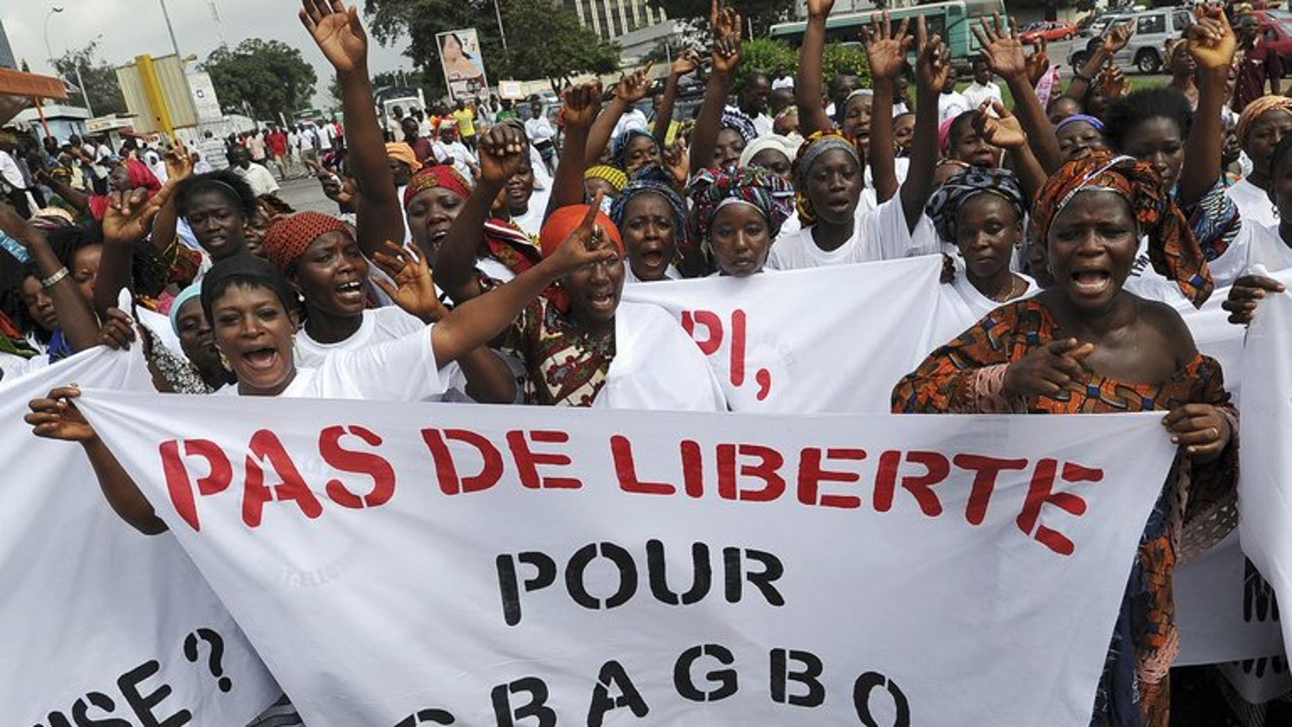 """Women hold a banner reading """"No Freedom for Gbagbo"""" during a demonstration for victims of the 2011 crisis in Ivory Coast, on June 17, 2013 in Abidjan. An Abidjan court on Monday released on bail 14 aides of former president Laurent Gbagbo, including his son Michel, who had been detained in the aftermath of Ivory Coast's deadly 2011 crisis."""