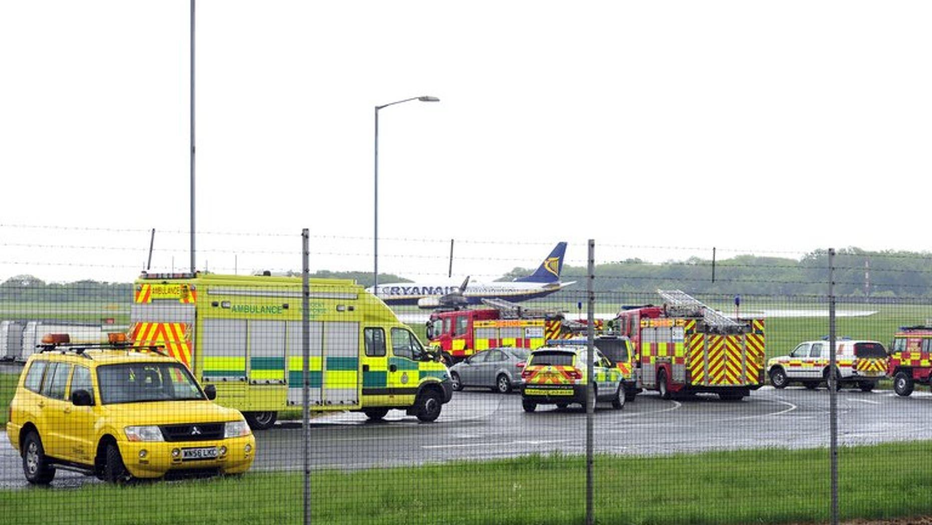 Emergency vehicles are pictured in Stansted Airport on May 24, 2013, shortly after a Pakistani International Airlines (PIA) plane landed. Two men accused of endangering a Pakistan International Airways plane denied the charges in an English court on Monday.