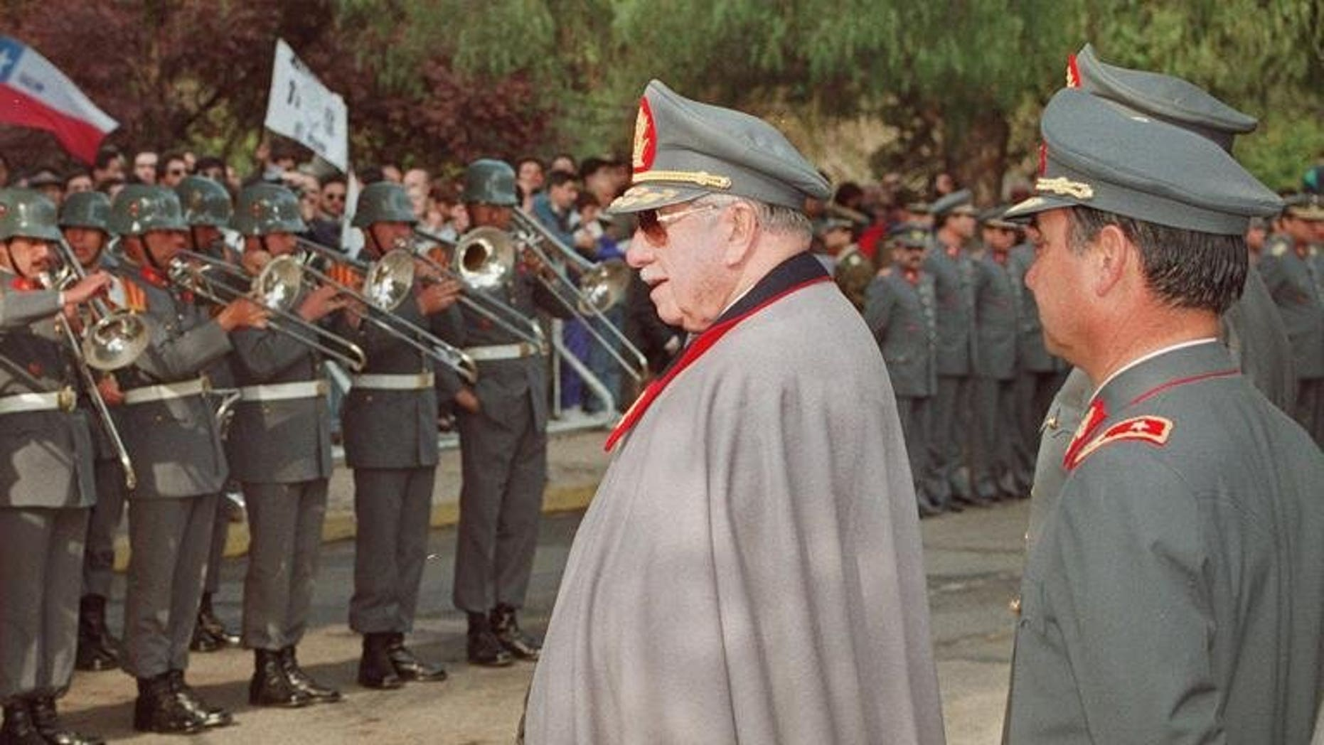 Picture taken on September 11, 1993 in Santiago of Commander of the Armed Forces General Augusto Pinochet, former Chilean president, participating in a rally in front of his home. A Chilean judge has closed a nine-year investigation into late dictator Augusto Pinochet's secret bank accounts abroad, without bringing charges against any member of the former president's family.