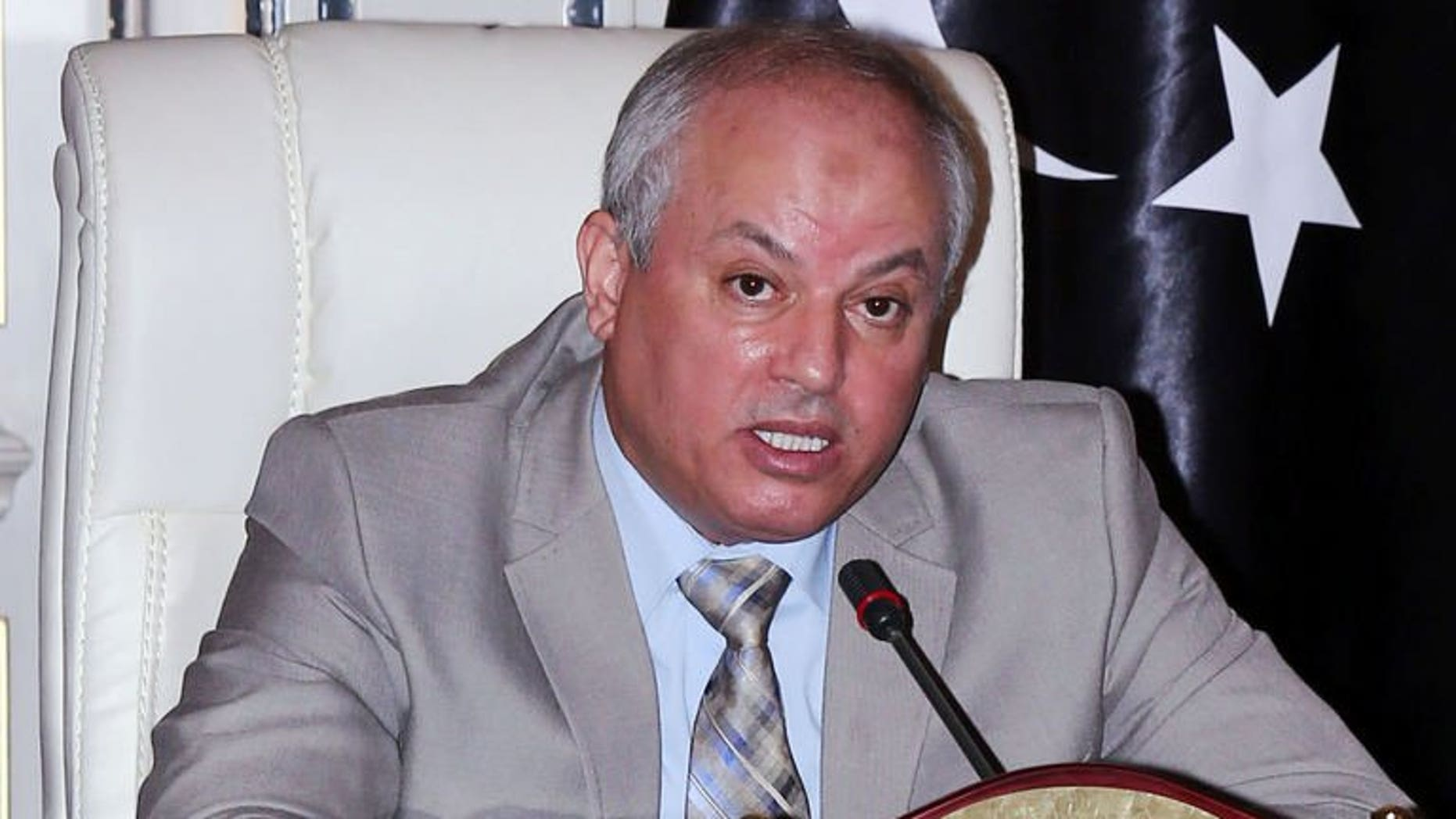 Libya's Minister of Oil and Gas Abdelbari al-Aroussi speaks during a press conference on August 5, 2013 in Tripoli. Aroussi said Libya's oil production have come back to normal after protesters forced the closure of exploration terminals.