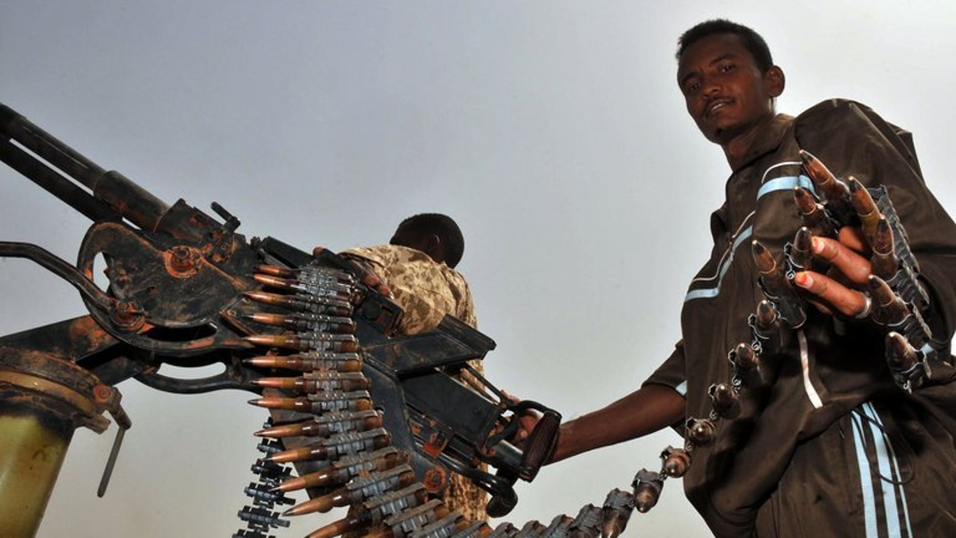 A Sudanese soldier poses with a machine gun in the town of Heglig bordering South Sudan on April 24, 2012. A Sudanese soldier has been killed in a border clash with South Sudanese forces.