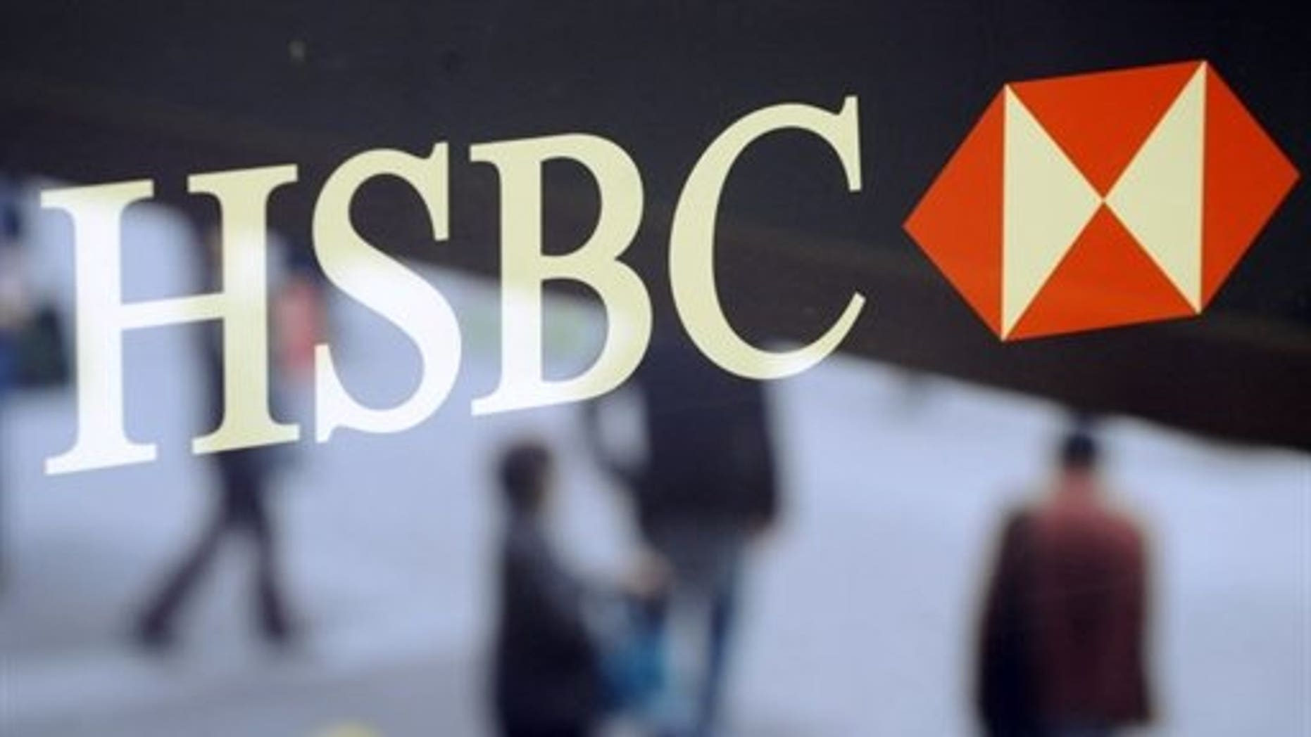 Shares in global banking giant HSBC fell almost five percent Tuesday after its interim results fell short of analysts' expectations.