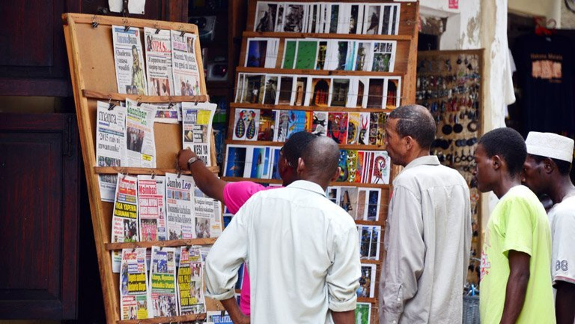 Local people look at a newspaper stand in Stone Town in Zanzibar on January 7. Journalists in Tanzania face increasing threats and lack government protection, with at least ten attacks against the media in the past year, the Committee to Protect Journalists said Tuesday.