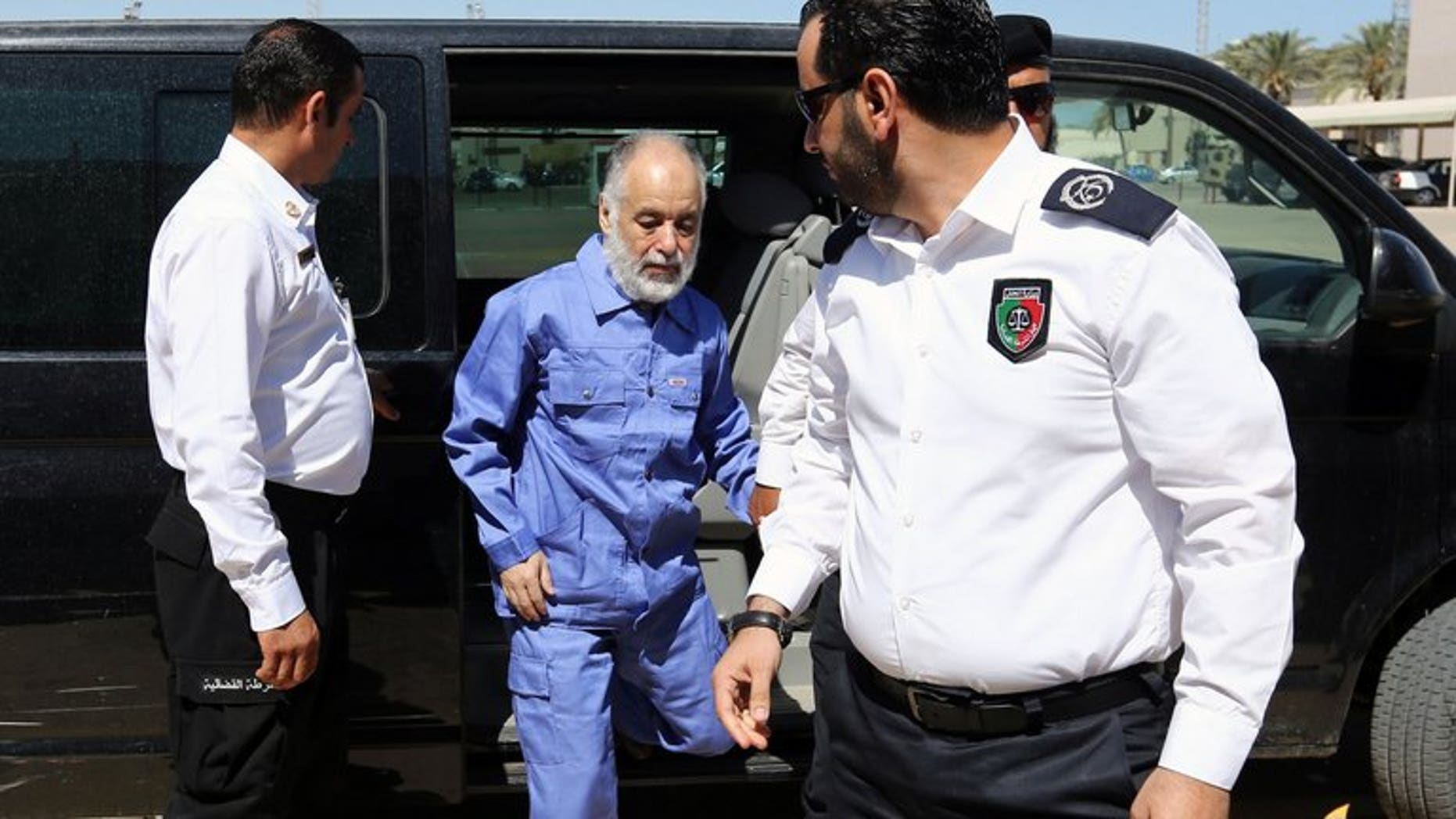 """Al-Baghdadi al-Mahmudi arrives at court for a hearing in his trial on June 12 in Tripoli. French lawyers for Moamer Kadhafi's last premier called Tuesday for his trial to be postponed after they were unable to secure visas to go and defend him, amid fears of """"revenge"""" justice in Libya."""