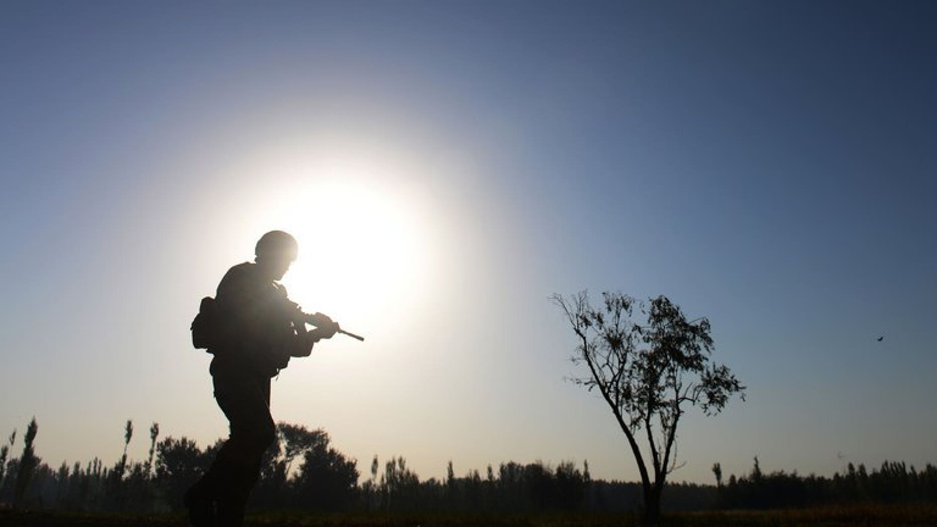 A soldier serving with the NATO-led International Security Assistance Force (ISAF) on patrol near Baraki Barak in Afghanistan's Logar Province, on October 13, 2012. NATO has confirmed that three foreign soldiers were killed during an insurgent attack in volatile eastern Afghanistan.