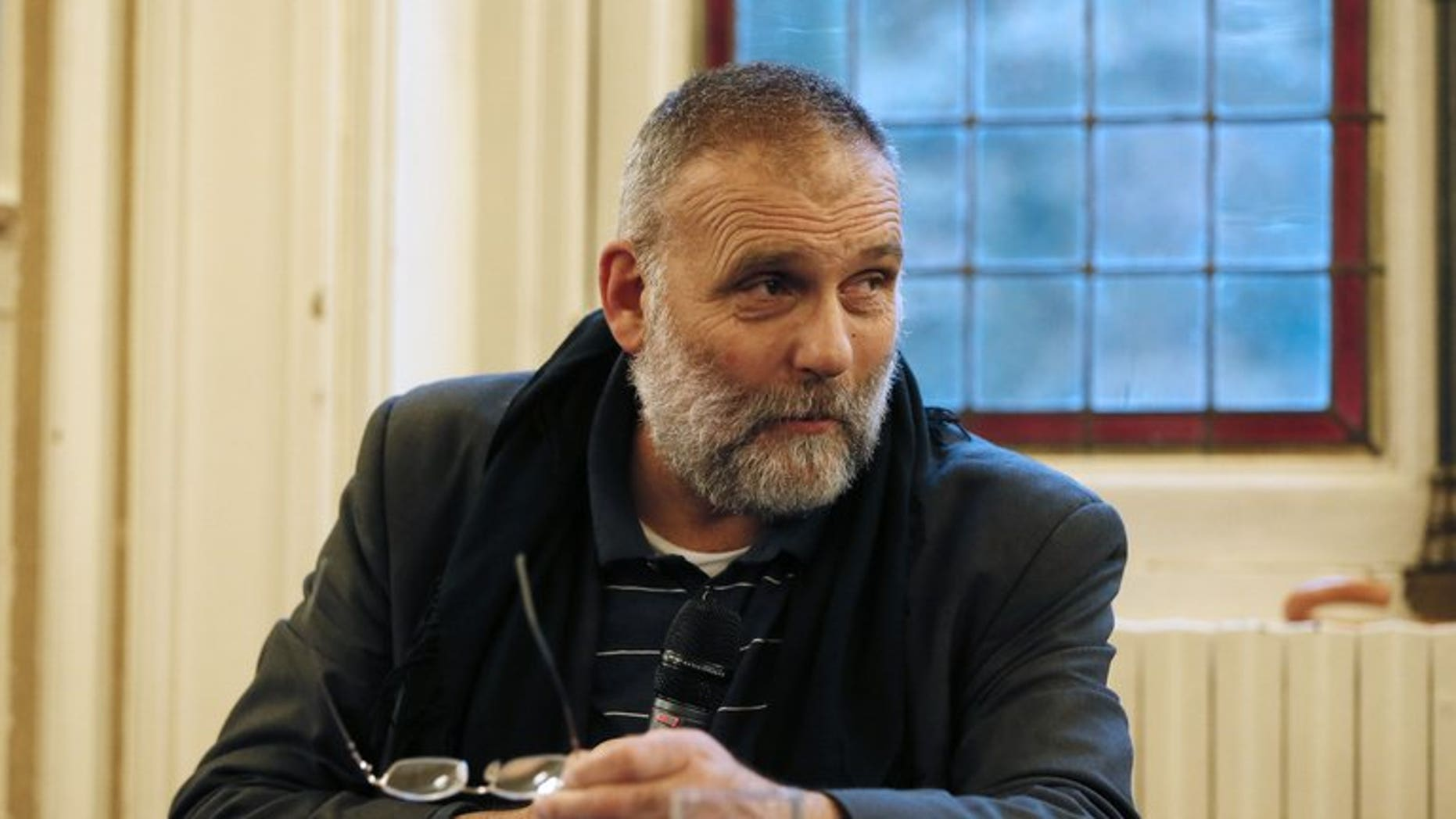 """Italian priest Paolo Dall'Oglio takes part in a conference on Syrian Christians on September 25, 2012 in Paris. Protesters have held daily demonstrations against jihadists in the northern Syrian city of Raqa, demanding the release of """"hundreds"""" of missing people including an Italian Jesuit priest, a watchdog said on Monday."""
