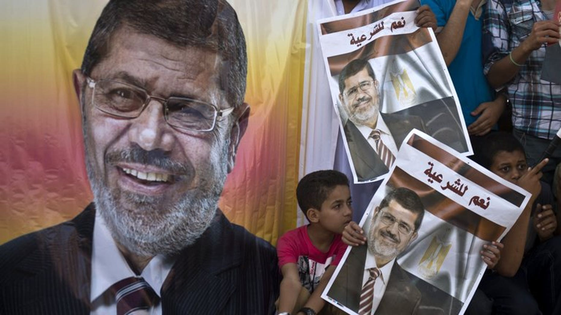 Supporters of deposed Egyptian president Mohamed Morsi watch a football match between the two main Cairo protest camps by members of the Muslim Brotherhood and supporters of the ousted Islamist leader in Cairo on August 11, 2013. Egypt's judiciary said Monday it was extending ousted president Mohamed Morsi's detention for a further 15 days pending an investigation into his collaboration with Hamas.