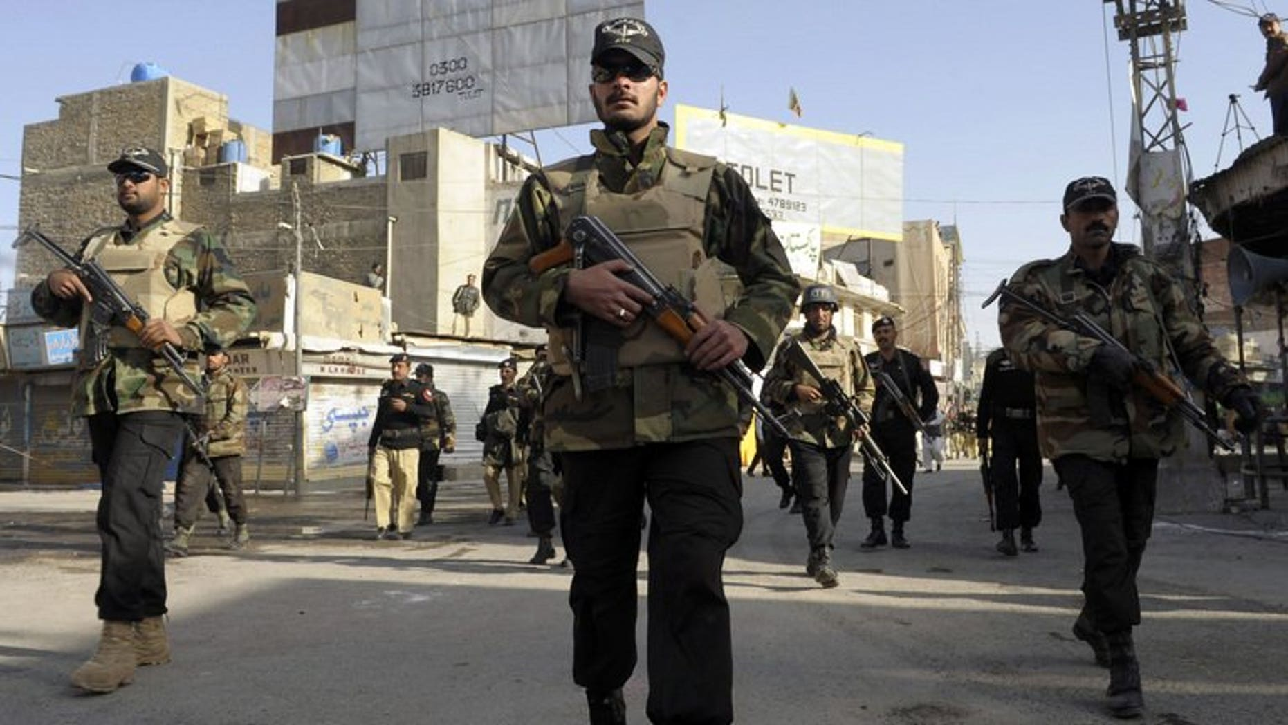 Pakistani police commandos patrol during a Shiite Muslim Ashura procession in Quetta on December 6, 2011. A bomb planted on a bicycle killed at least two people and wounded another in the restive province of Baluchistan in southwest Pakistan on Monday, officials said.