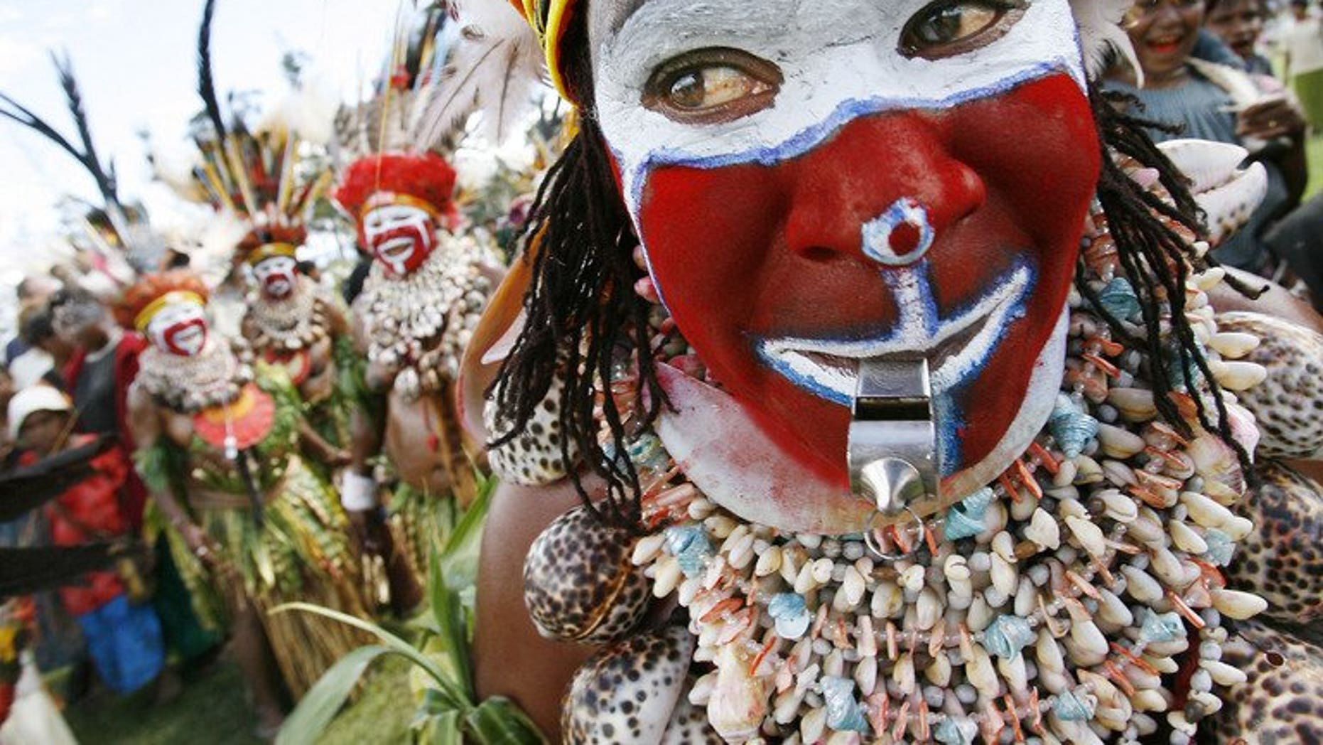 """This file illustration photo shows Moki Angimb women performing during a cultural show in Mount Hagen, on August 18, 2007. Women in poverty-stricken Papua New Guinea suffer """"severe brutality"""" with violence, including savage attacks involving knives, axes and whips, occurring in two-thirds of all families, according to a recent study."""