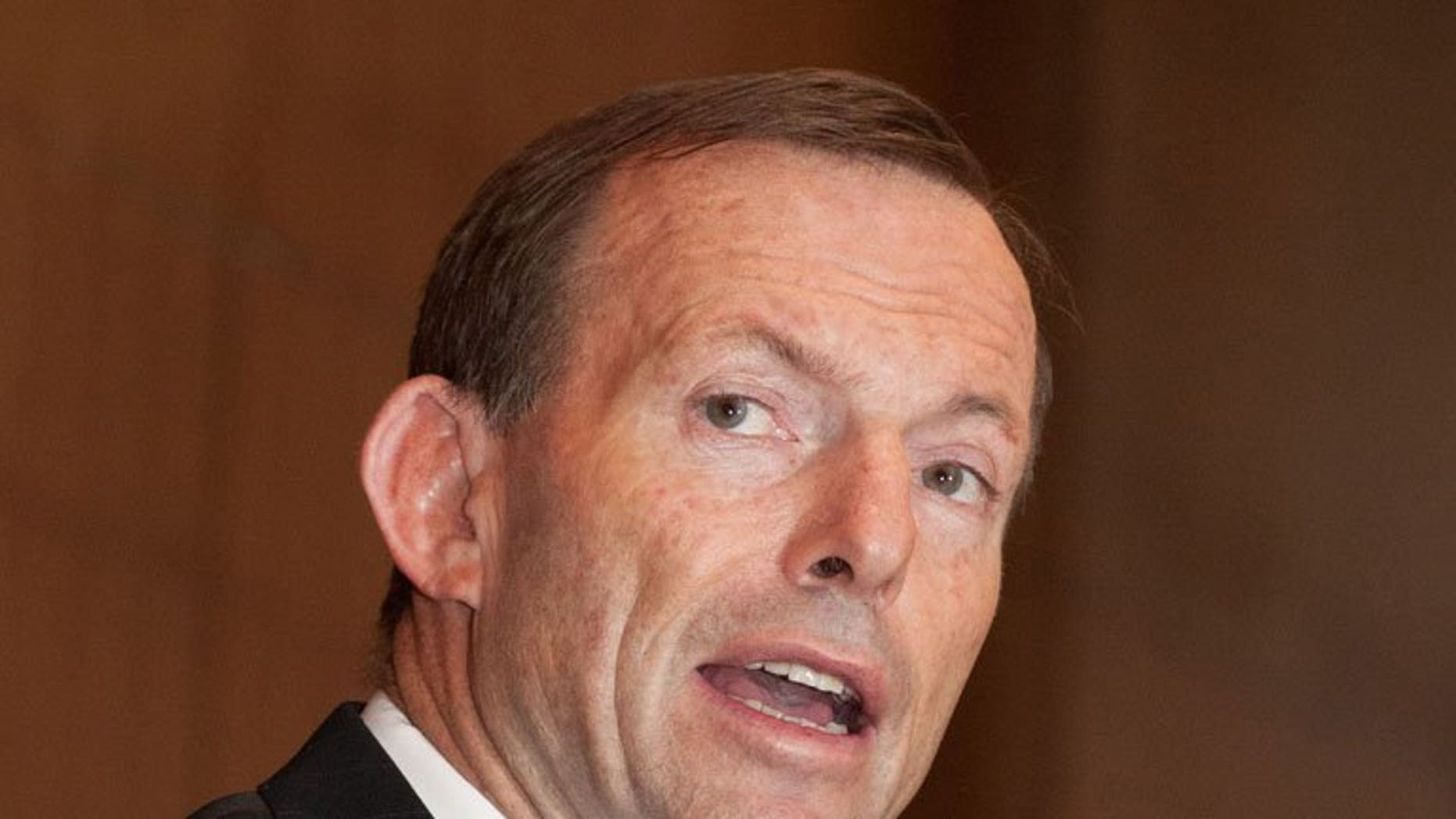 """Australian opposition leader Tony Abbott delivers a speech in Beijing, on July 24, 2012. Abbott -- accused last year of misogyny in a blistering speech by then-prime minister Julia Gillard -- is under fire after touting the """"sex appeal"""" of an election candidate."""