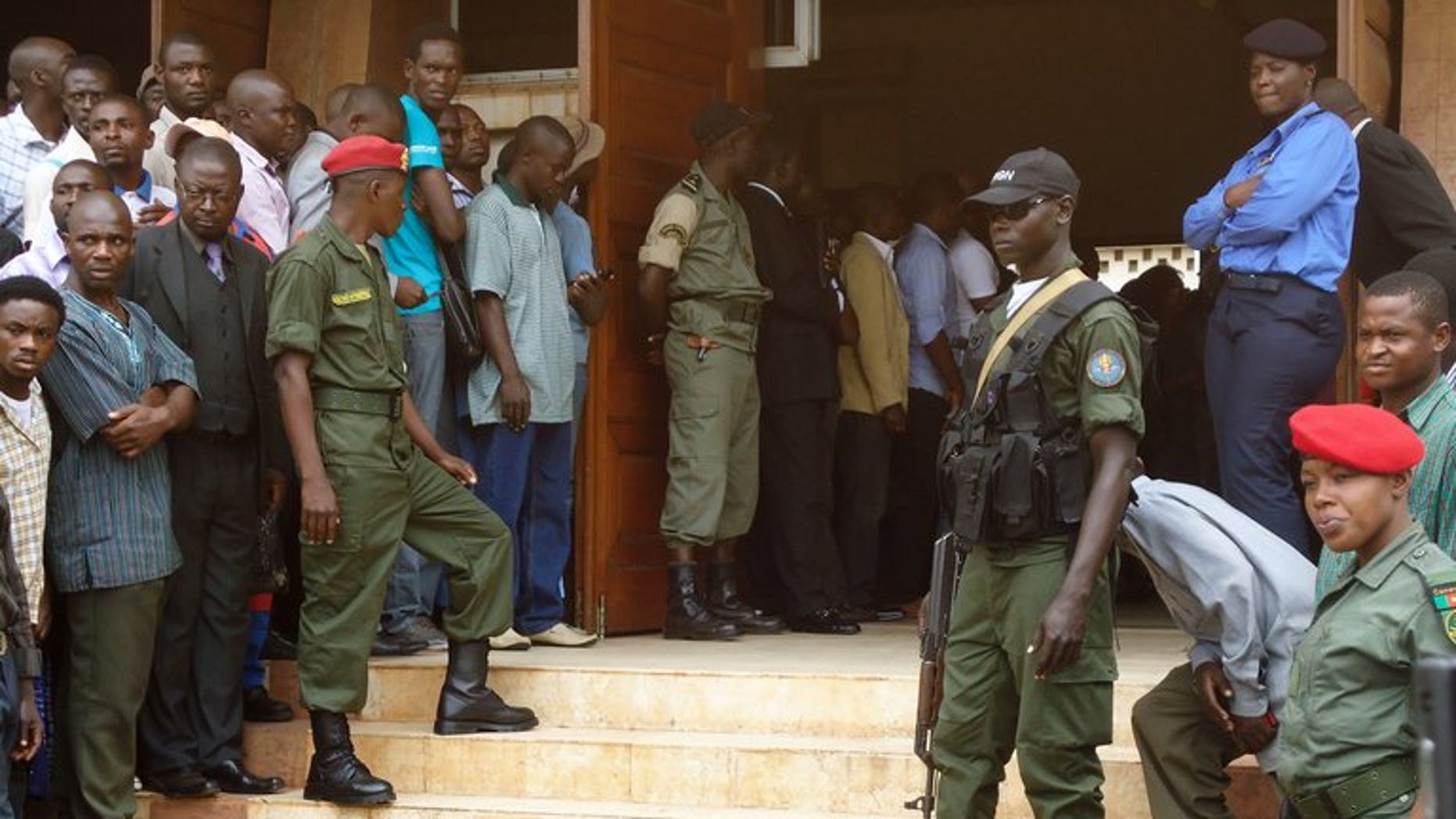 Policemen stand at the entrance of a court in Yaounde on July 16, 2012. A Cameroonian court has sentenced a former health minister to 20 years in prison for corruption over a fake contract to deliver mosquito nets to hospitals, legal sources said.