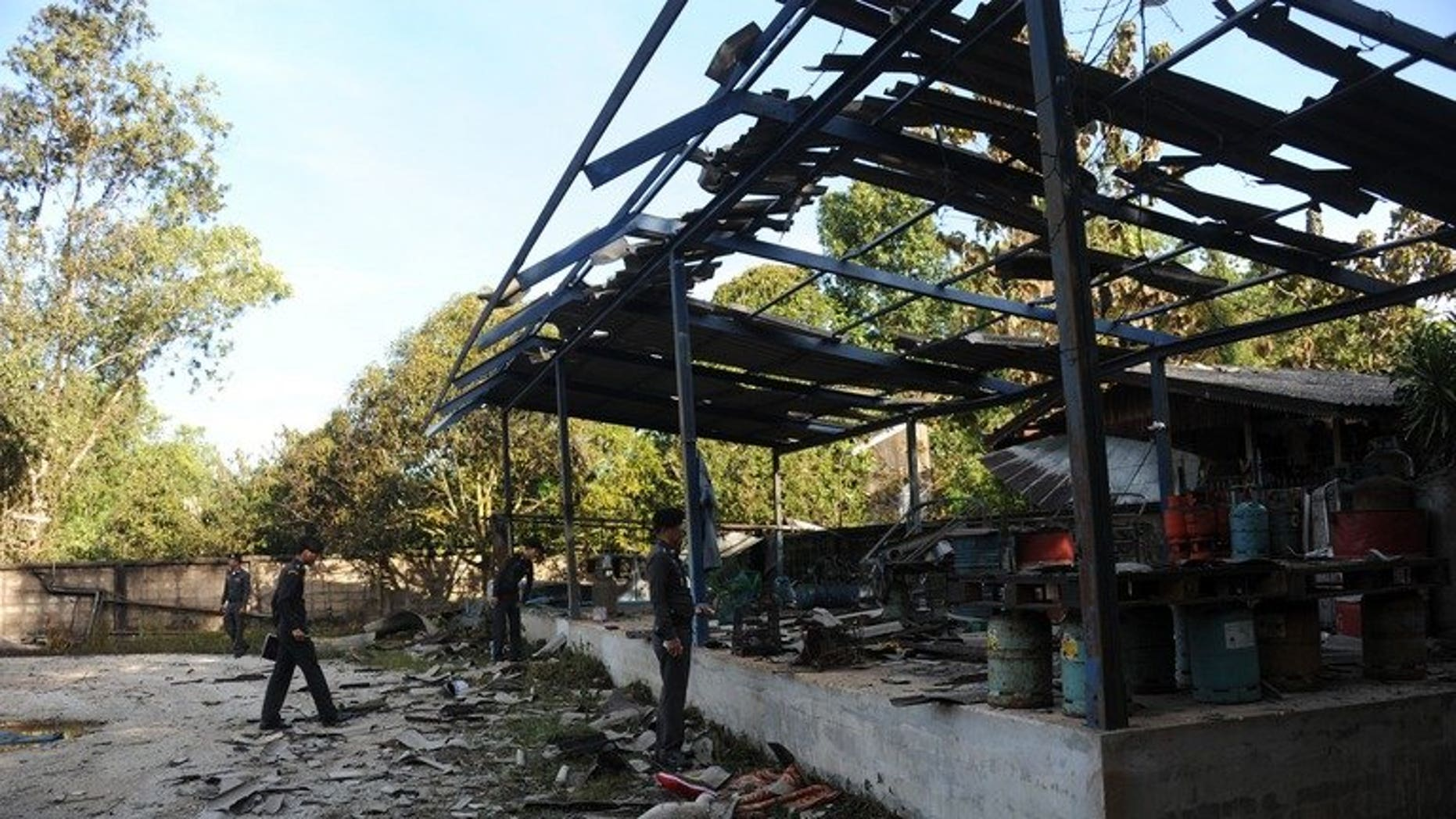 Thai police inspect a gas factory after a bomb blast in the restive southern province of Narathiwat, on August 11, 2013. A policeman has been killed and nine other people wounded in a bomb attack in Thailand's insurgency-hit deep south, as authorities vowed talks with rebels will continue.