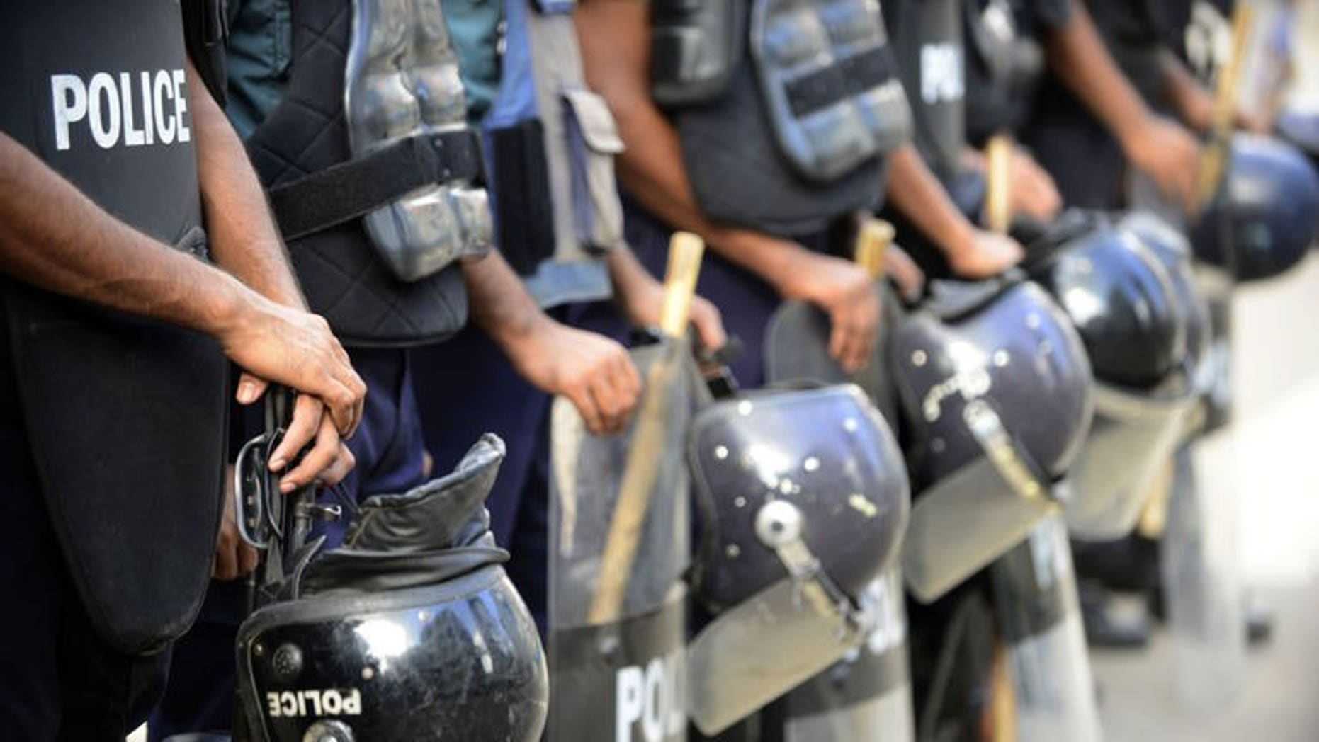 Bangladeshi police stand guard during a nationwide strike called by the Jumaat-e-Islami party in Dhaka, on August 13, 2013. Bangladesh police have fired rubber bullets and tear gas at supporters of the country's largest Islamist party as they protested against a ban preventing it from contesting next year's general elections.