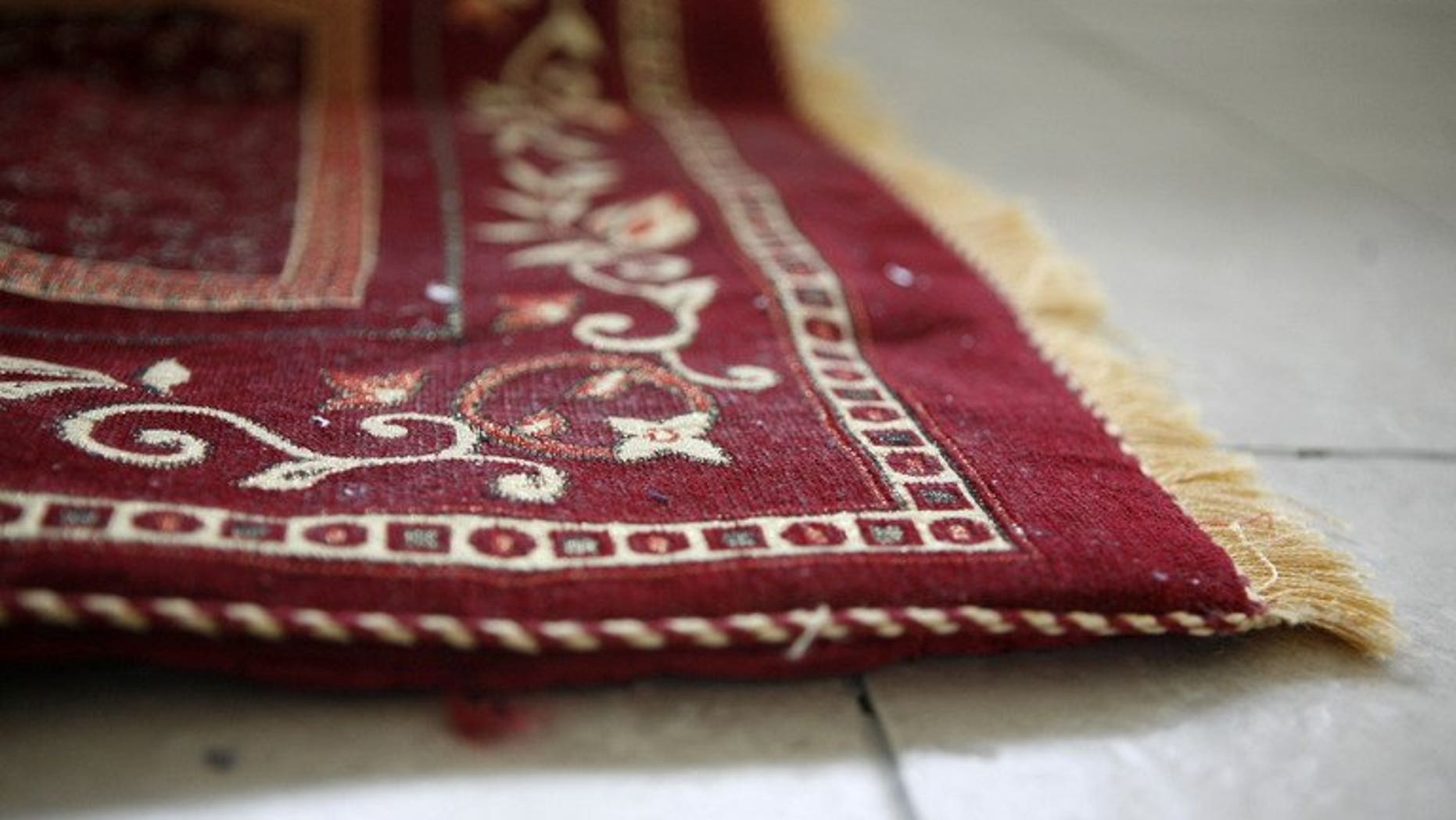 A prayer rug pictured on November 12, 2009 in Killeen, Texas. Malaysian police said Tuesday they have arrested a resort owner after he allowed Buddhists to use a Muslim prayer room in the country's latest religious controversy.