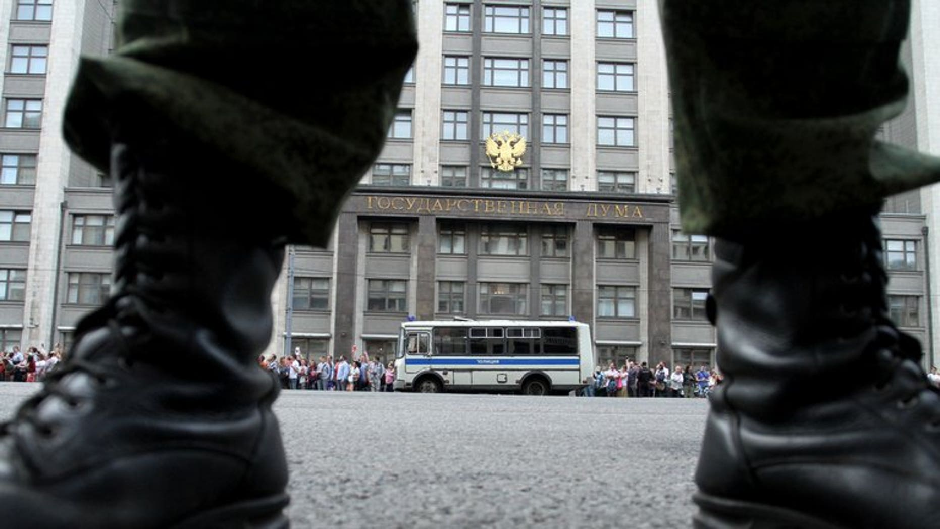 A soldier stands guard in front of the State Duma in Moscow, on July 18, 2013. Russian police have arrested a Siberian surgeon on suspicion of stealing heroin that he had extracted from the stomach of a drug mule.