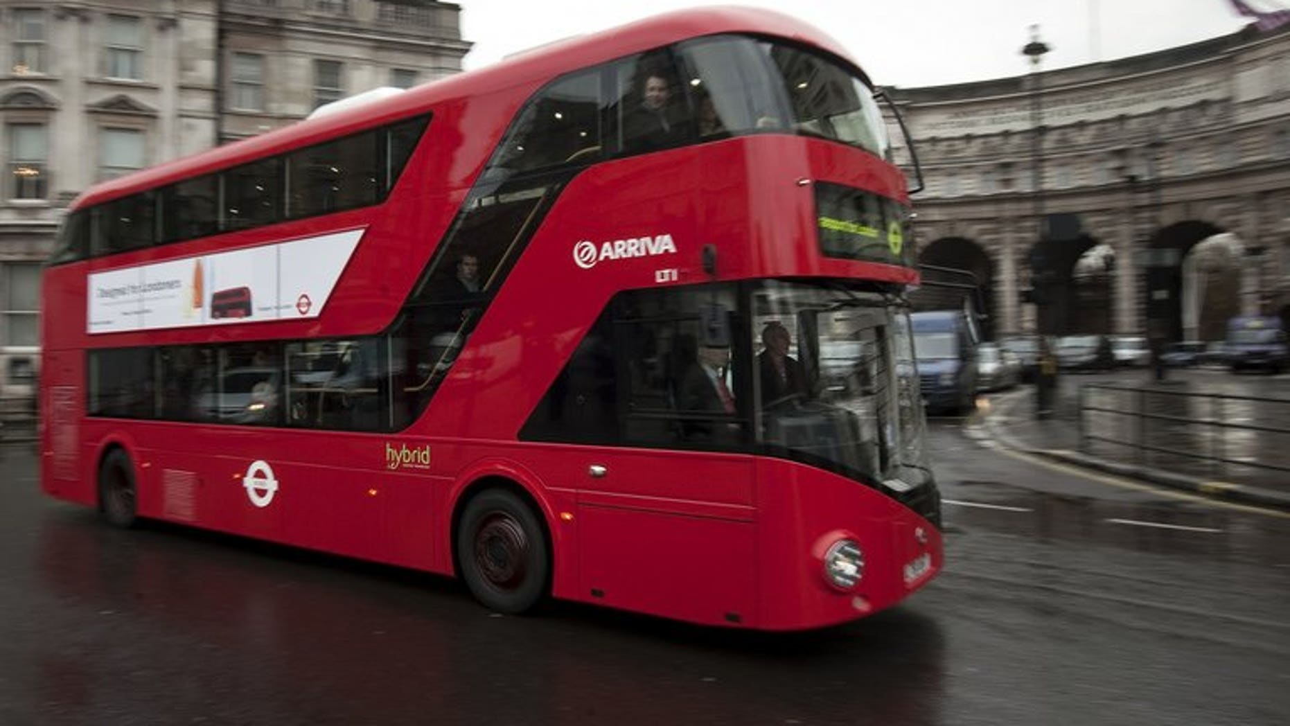 A bus drives along a street in central London on December 16, 2011. There's a screaming head by Francis Bacon at the bus stop, and a landscape by John Constable in a shopping centre -- just some of the art forming part of a novel exhibition in Britain.