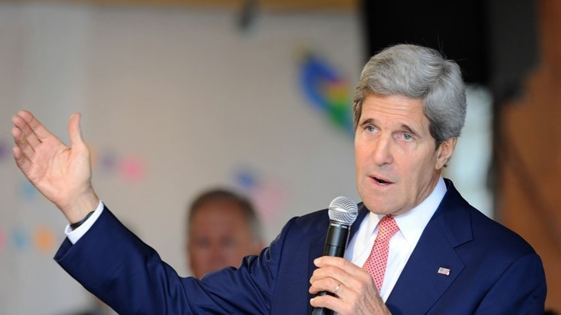 US Secretary of State John Kerry delivers a speech for US embassy employes and relatives in an event in Brasilia on August 13, 2013. Palestinian president Mahmud Abbas is committed to pursuing peace talks with Israel despite the unresolved issue of Israeli settlement building, Kerry said.