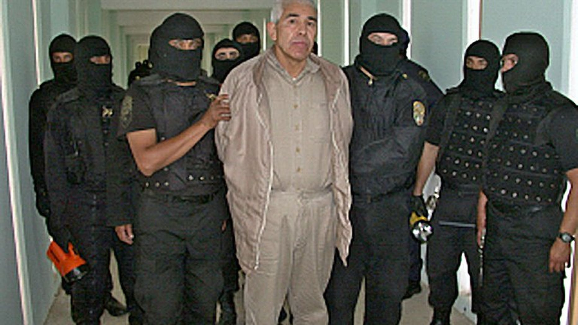 This file photo shows Rafael Caro Quintero (C), a drug lord convicted of killing a US drug agent in 1985, under custody at the 'Puente Grande' prison in Guadalajara, on January 29, 2005. Caro Quintero had another 12 years to go in his sentence, and could have faced additional charges in the US, but on August 7 a judge in the western state of Jalisco ordered his release on a technicality.