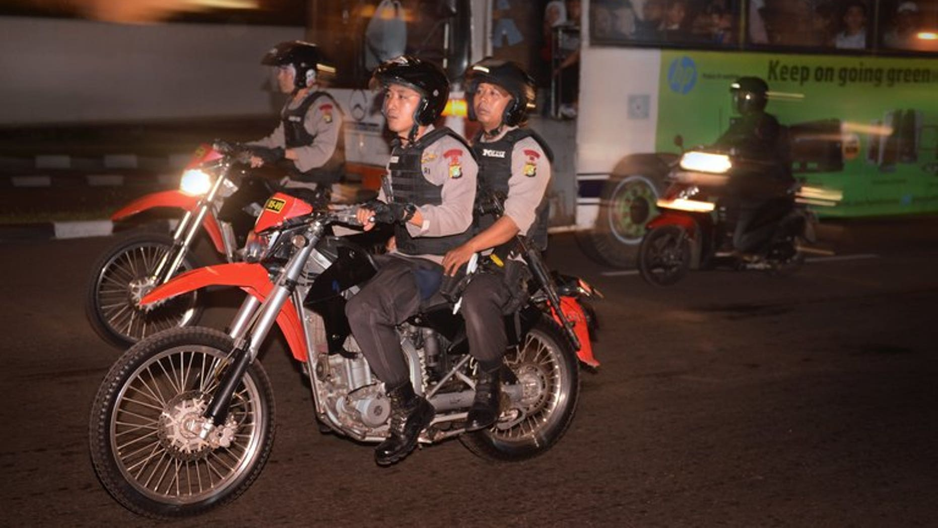Police officers patrol on motorcycles around the capital city of Jakarta on August 5, 2013. Indonesia's anti-corruption agency has arrested the head of the country's upstream oil and gas regulator over allegations of bribery, an official said Wednesday.