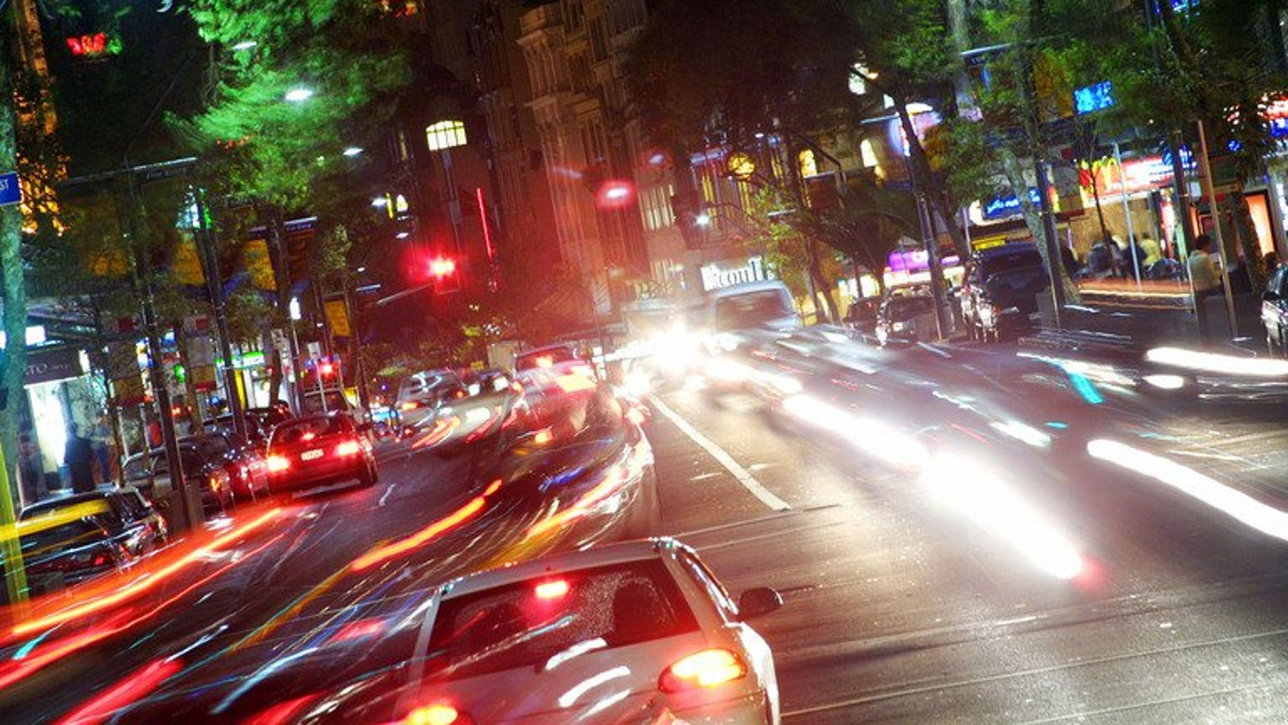 Cars and people make their way up and down Auckland's Queen Street on July 1, 2003. A New Zealand woman drove for hundreds of kilometres (miles) while asleep at the wheel, sending texts from her mobile phone along the way, police said Wednesday.