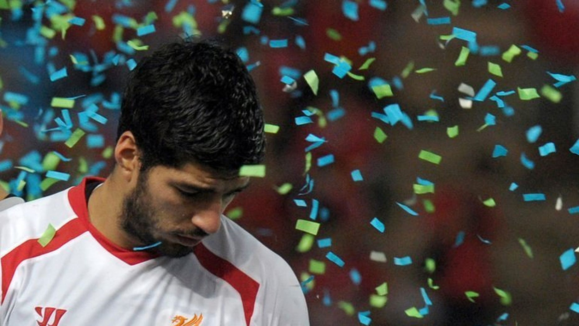 Liverpool football player Luis Suarez reacts after the match against Thailand at Rajamangala National Stadium in Bangkok on July 28, 2013. Suarez has said he will stay at Liverpool, despite being unsettled at the English Premier League side and seeking a transfer, El Observador newspaper said on Wednesday.