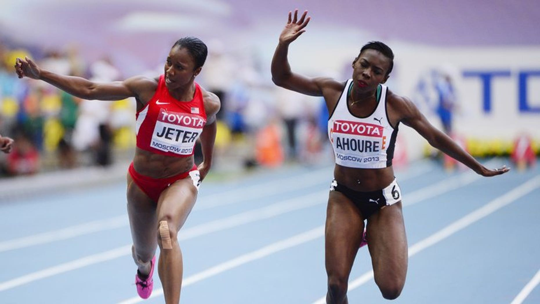 US's Carmelita Jeter and Ivory Coast's Murielle Ahoure (right) compete in heat 2 of the women's 100 metres semi-final at the 2013 IAAF World Championships at the Luzhniki stadium in Moscow on August 12, 2013. Ahoure made history in becoming the first female African sprinter to win a medal in the history of the World Athletics Championships in the 100 metres.